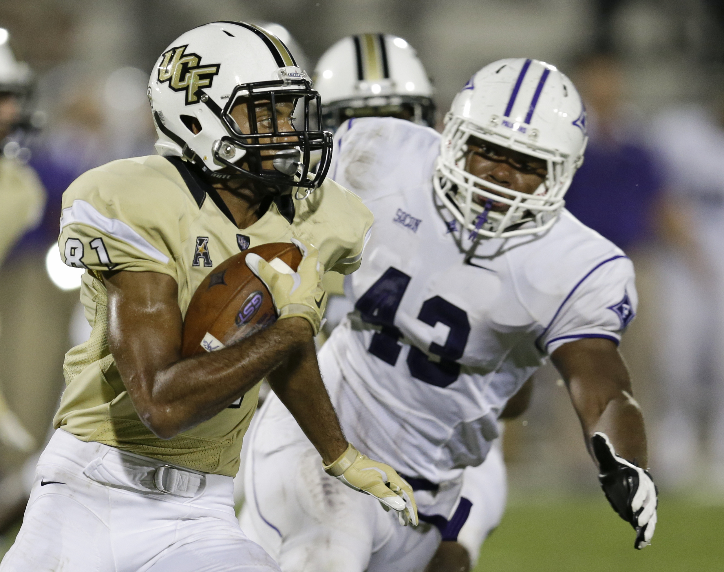 Central Florida wide receiver Chris Johnson (81) runs after a reception as Furman linebacker Brad Minter (43), tries to stop him during the second half an NCAA college football game, Saturday, Sept. 19, 2015, in Orlando, Fla. Furman won 16-15. (John Raoux/AP)