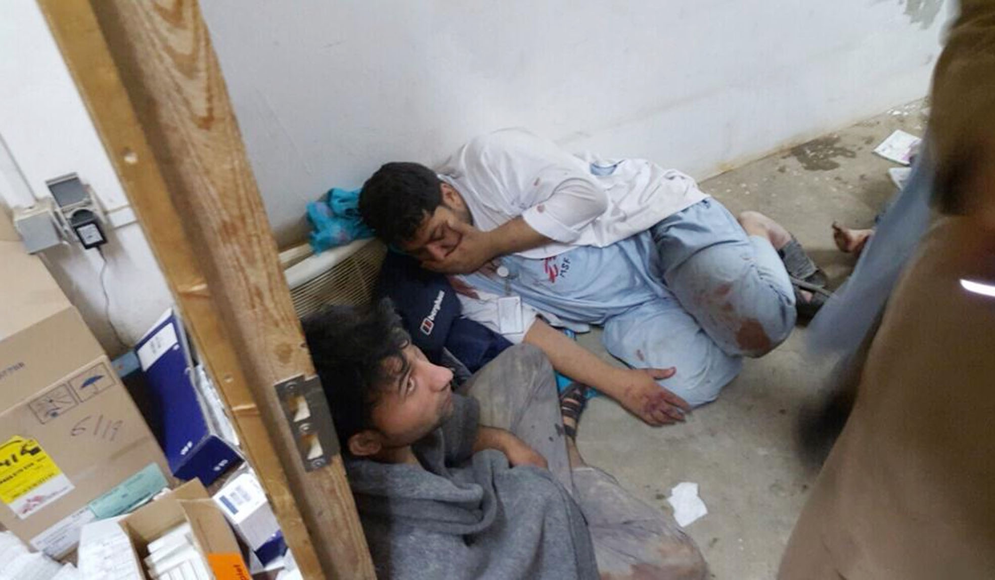 Injured Doctors Without Borders staff are seen after explosions near their hospital in the northern Afghan city of Kunduz, Saturday, Oct. 3, 2015. Doctors Without Borders announced that the death toll from the bombing of the group's Kunduz hospital compound has risen to at least 16, including 3 children and that tens are missing after the explosions that may have been caused by a U.S. airstrike. (Médecins Sans Frontières via AP)