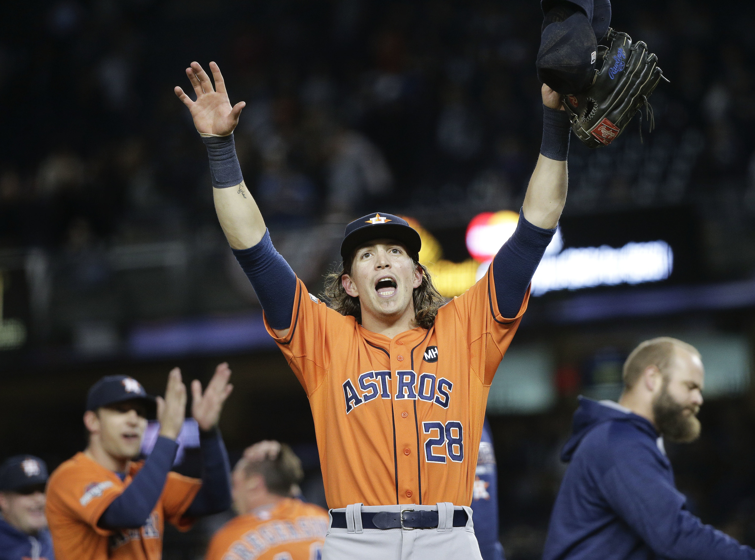 Houston Astros left fielder Colby Rasmus (28) motions to fans after the Astros defeated the New York Yankees 3-0 in the American League wild card baseball game, Tuesday, Oct. 6, 2015, in New York. (Julie Jacobson/AP)