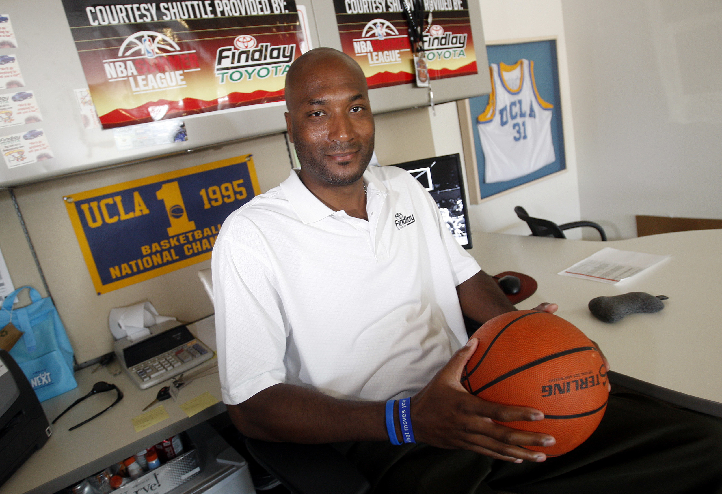 In this Sept. 18, 2010, file photo, former UCLA basketball player Ed O'Bannon Jr. sits in his office in Henderson, Nev. A federal appeals court agreed Wednesday, Sept. 30, 2015, that the NCAA's use of college athletes' names, images and likenesses in video games and TV broadcasts violated antitrust laws but struck down a plan to allow schools to pay players up to $5,000. The decision came in a lawsuit filed by O'Bannon and 19 others. (Isaac Brekken, File/AP)