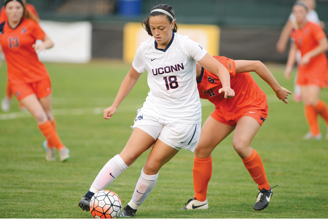 UConn redshirt junior forward Stephanie Ribeiro dribbles away from a Syracuse defender during the Huskies' game at Joseph J. Morrone Stadium in Storrs, Connecticut on Sept. 3. 2015. Ribeiro scored the game's lone goal to lift UConn over the Orange 1-0. (Jason Jiang/The Daily Campus)