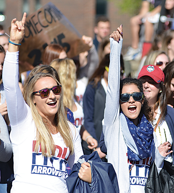 In this photo, members of the Pi Beta Phi sorority march during UConn's Homecoming Parade on Sunday, Oct. 11, 2015. (Jason Jiang/The Daily Campus)