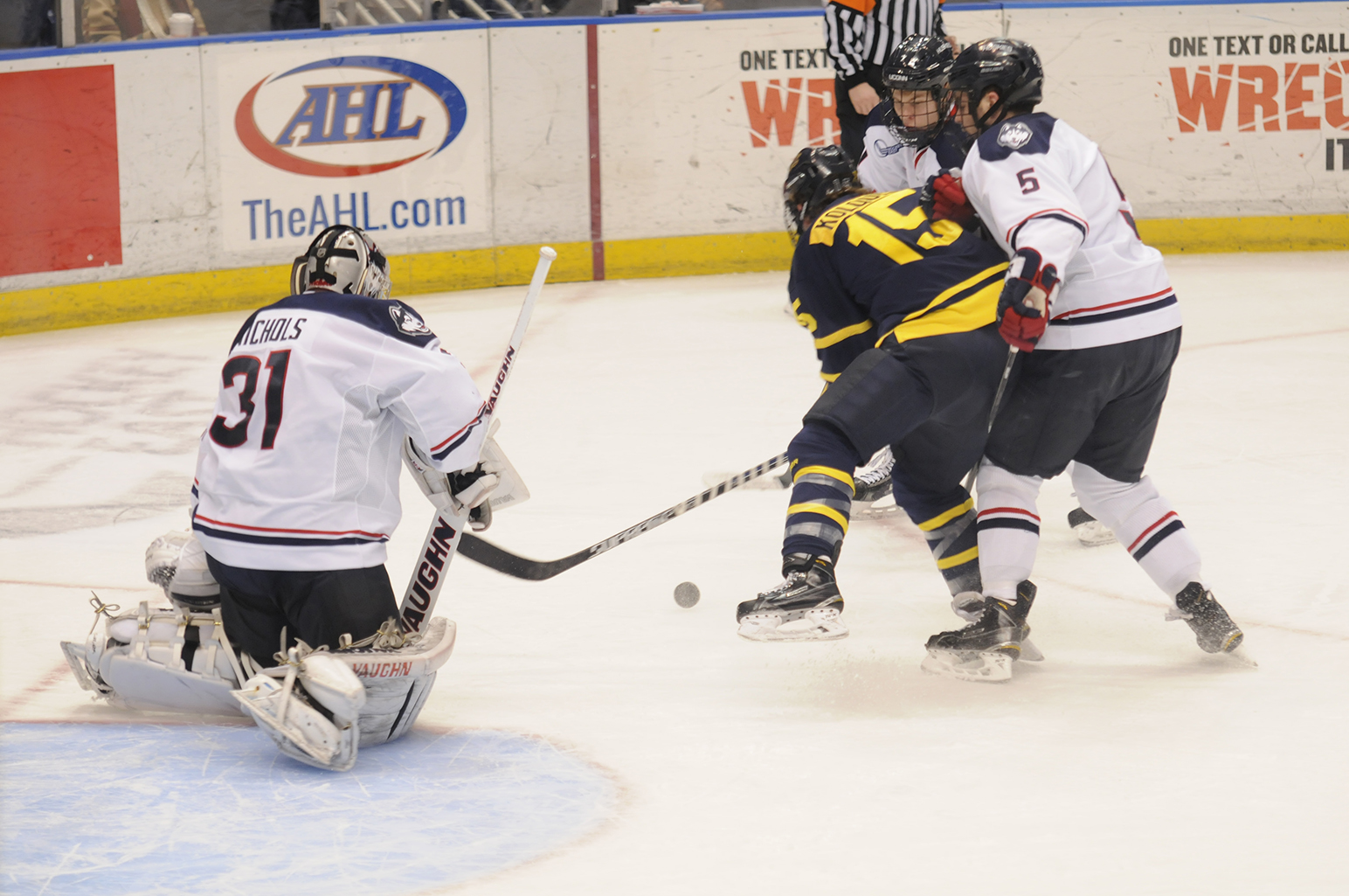 In this file photo, UConn goaltender Rob Nichols (31) goes down to make a save during the Huskies' game against Merrimack at XL Center in Hartford, Connecticut on Tuesday, Feb. 10, 2015. (File Photo/The Daily Campus)