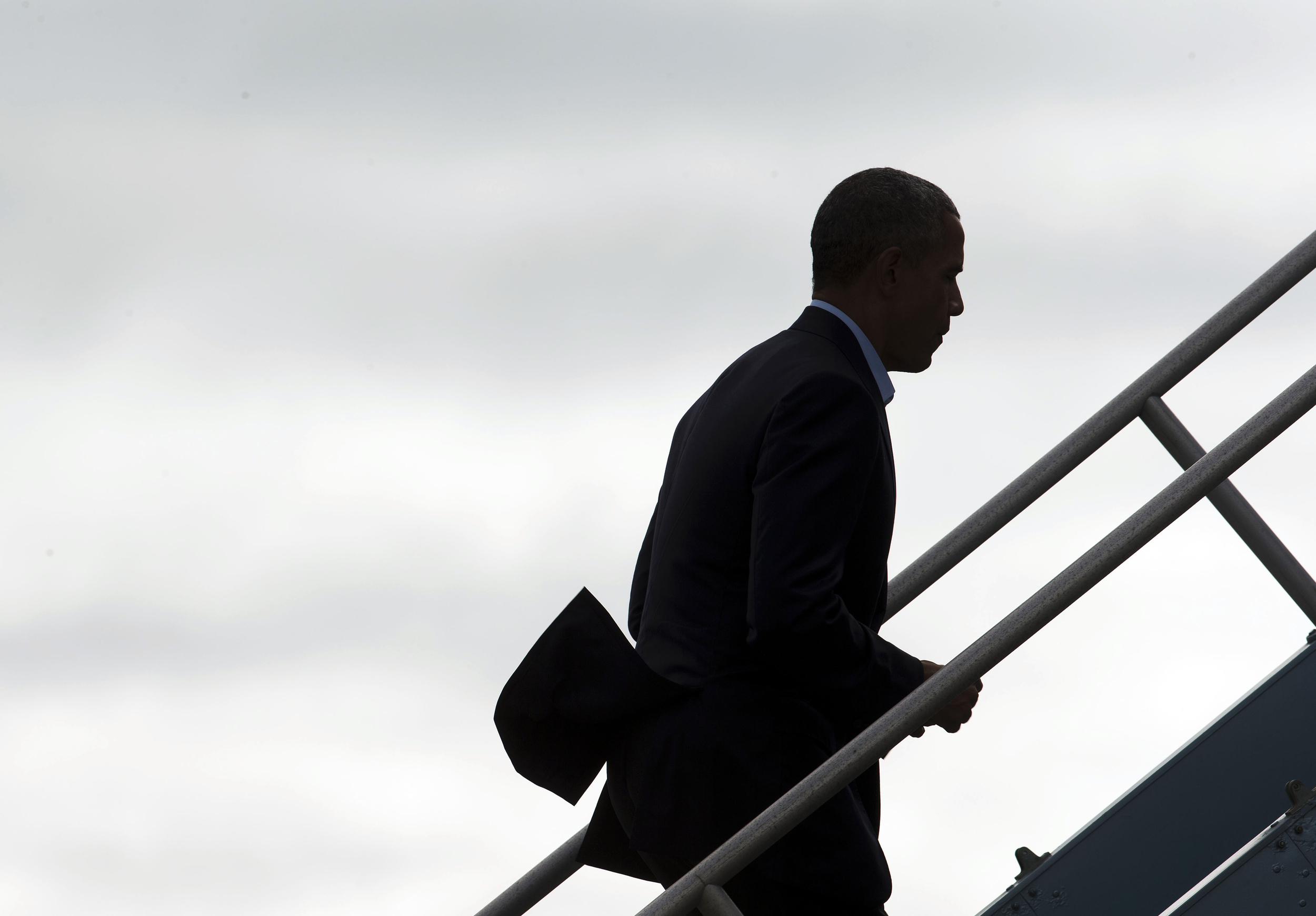 President Barack Obama goes up the stairs as he boards Air Force One at San Francisco International Airport, Saturday, Oct. 10, 2015 in San Francisco. Obama is on a four-day West Coast tour that includes democratic fundraisers along the way. (Pablo Martinez Monsivais/AP)