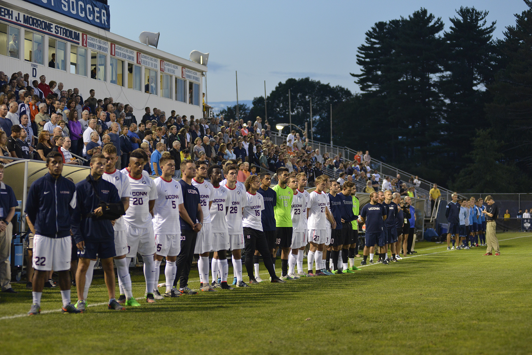 UConn men's soccer team players, coaches and staff stand on the sideline at Joseph J. Morrone Stadium prior to the team's game against Rhode Island in Storrs, Connecticut on Saturday, Sept. 19, 2015. (Jason Jiang/The Daily Campus)