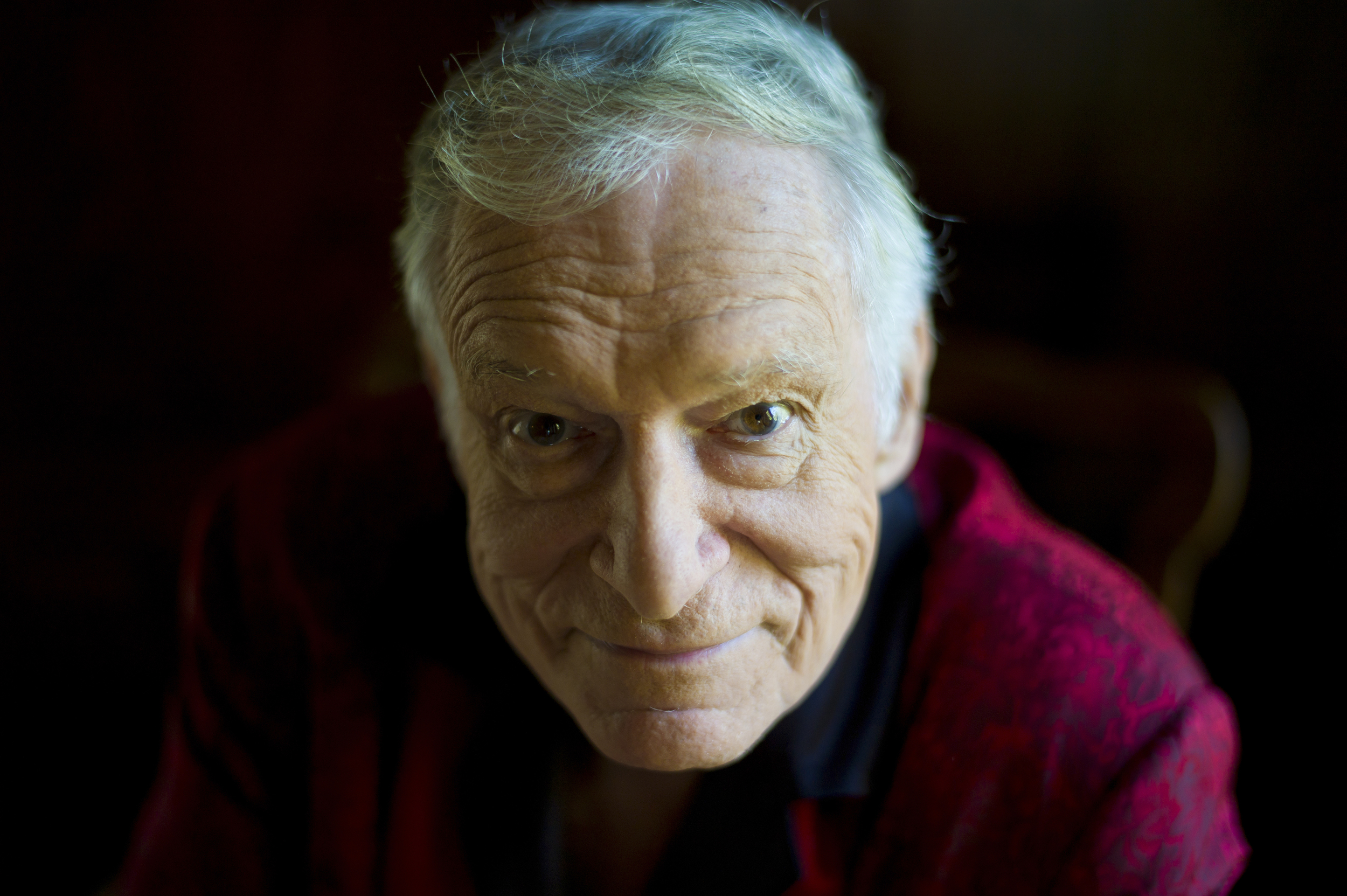 In this Oct. 13, 2011 file photo, American magazine publisher, founder and Chief Creative Officer of Playboy Enterprises, Hugh Hefner at his home (aka Playboy Mansion) in Beverly Hills, Calif. Playboy will no longer publish photos of nude women as part of a redesign of the decades-old magazine, according to a news report Monday, Oct. 12, 2015. (Kristian Dowling, File/AP)