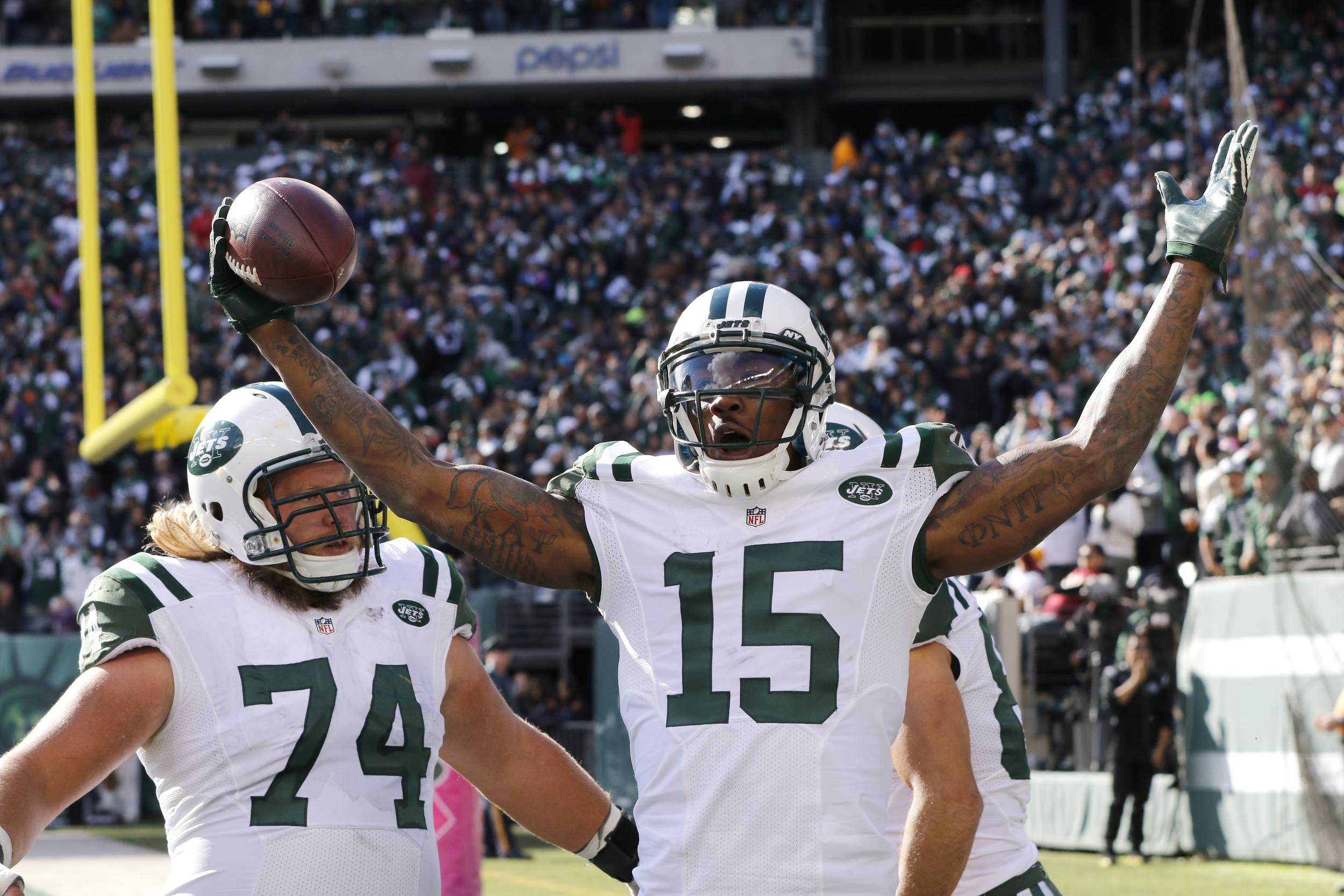 New York Jets wide receiver Brandon Marshall (15) celebrates with teammates Nick Mangold (74) and Eric Decker (87) after scoring on a touchdown pass from quarterback Ryan Fitzpatrick, not pictured, during the second half of an NFL football game against the Washington Redskins, Sunday, Oct. 18, 2015, in East Rutherford, N.J. (Gary Hershorn/AP)