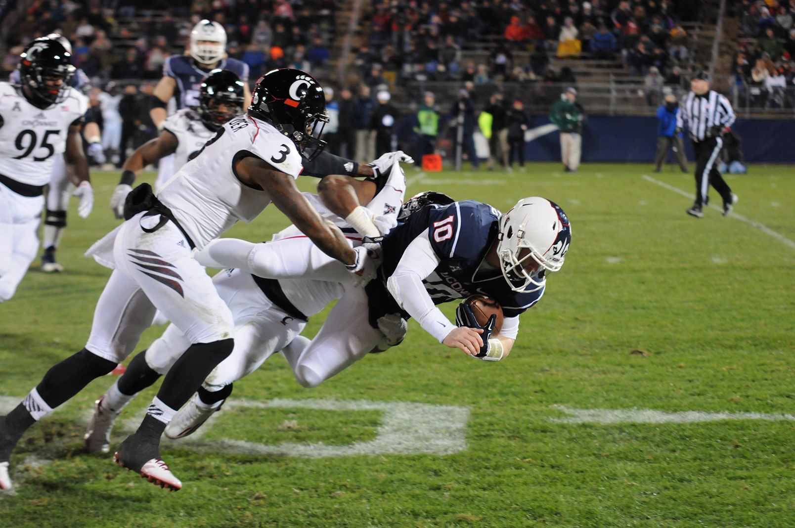 Quarterback Chandler Whitmer dives forward for UConn in last season's 41-0 loss against Cincinnati. The Huskies will take on the Bearcats this Saturday. (File Photo/Daily Campus)