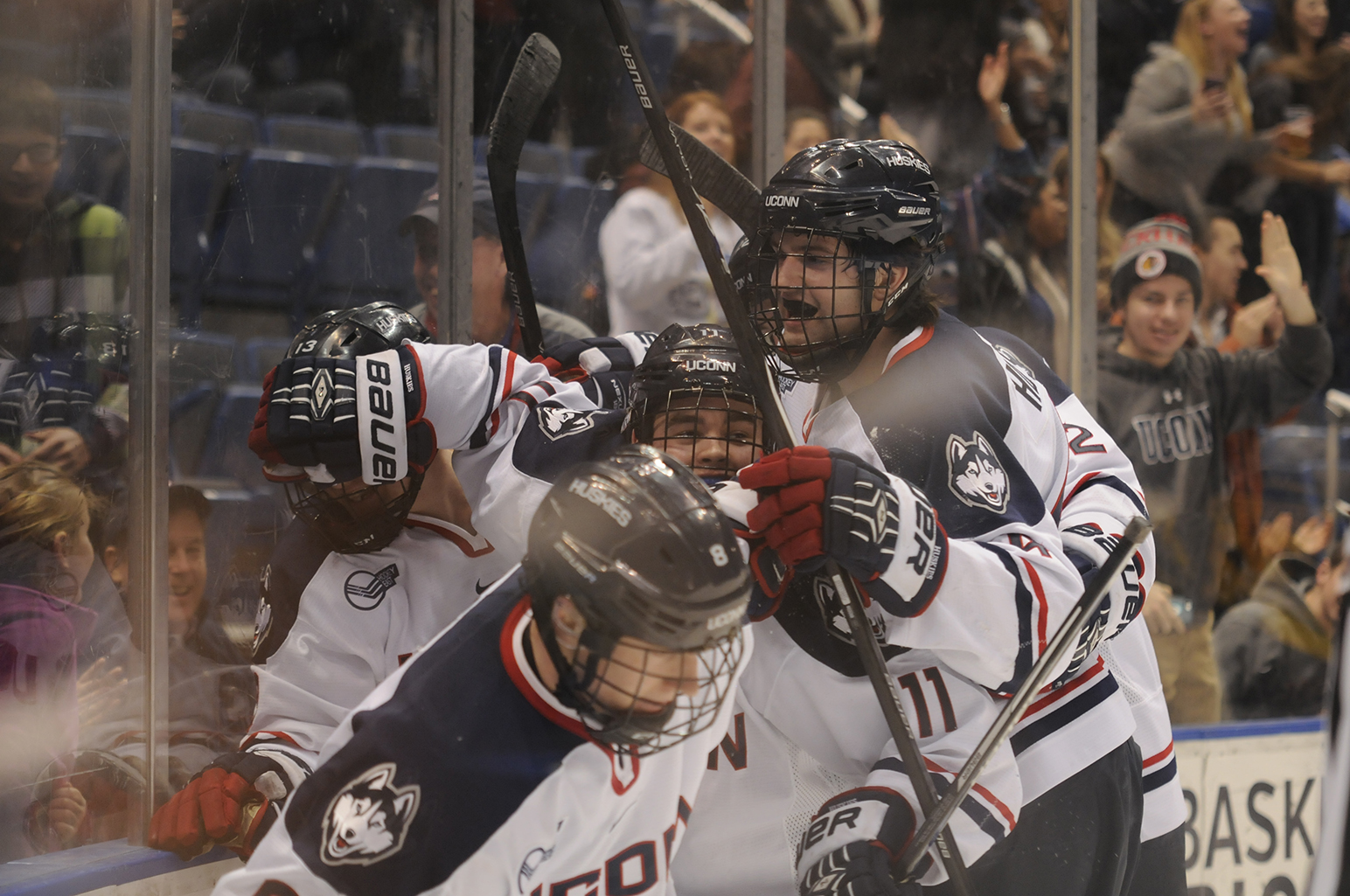 In this photo, members of the UConn men's ice hockey team are seen celebrating after a late goal that earned them a 1-0 victory over Merrimack at the XL Center in Hartford, Connecticut on Feb. 10, 2015. (File Photo/The Daily Campus)