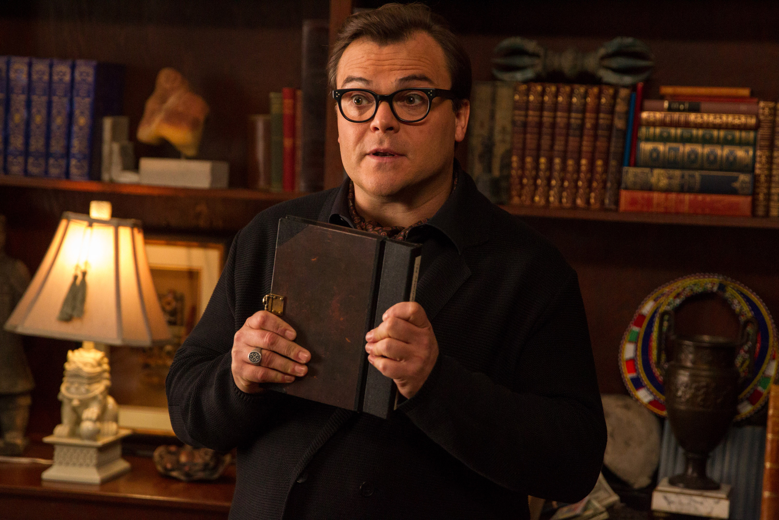 "In this photo provided by Columbia Pictures, Jack Black who stars as R.L. Stine, Slappy, and Invisible Boy, appears in a scene in Columbia Pictures' ""Goosebumps"