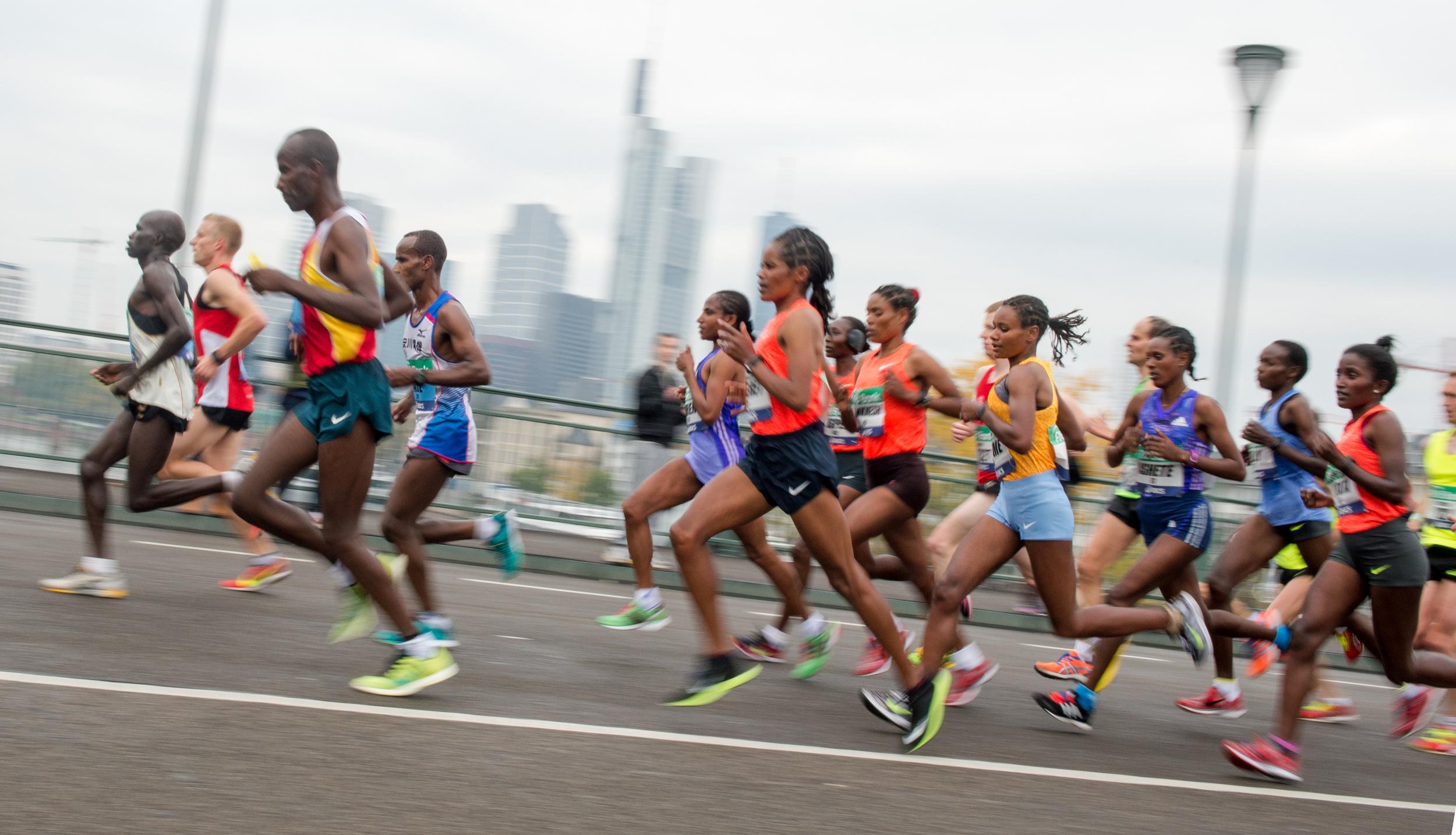 Participants run across a bridge over river Main, during the Frankfurt marathon in Frankfurt, central Germany, Sunday Oct. 25, 2015. (AP)