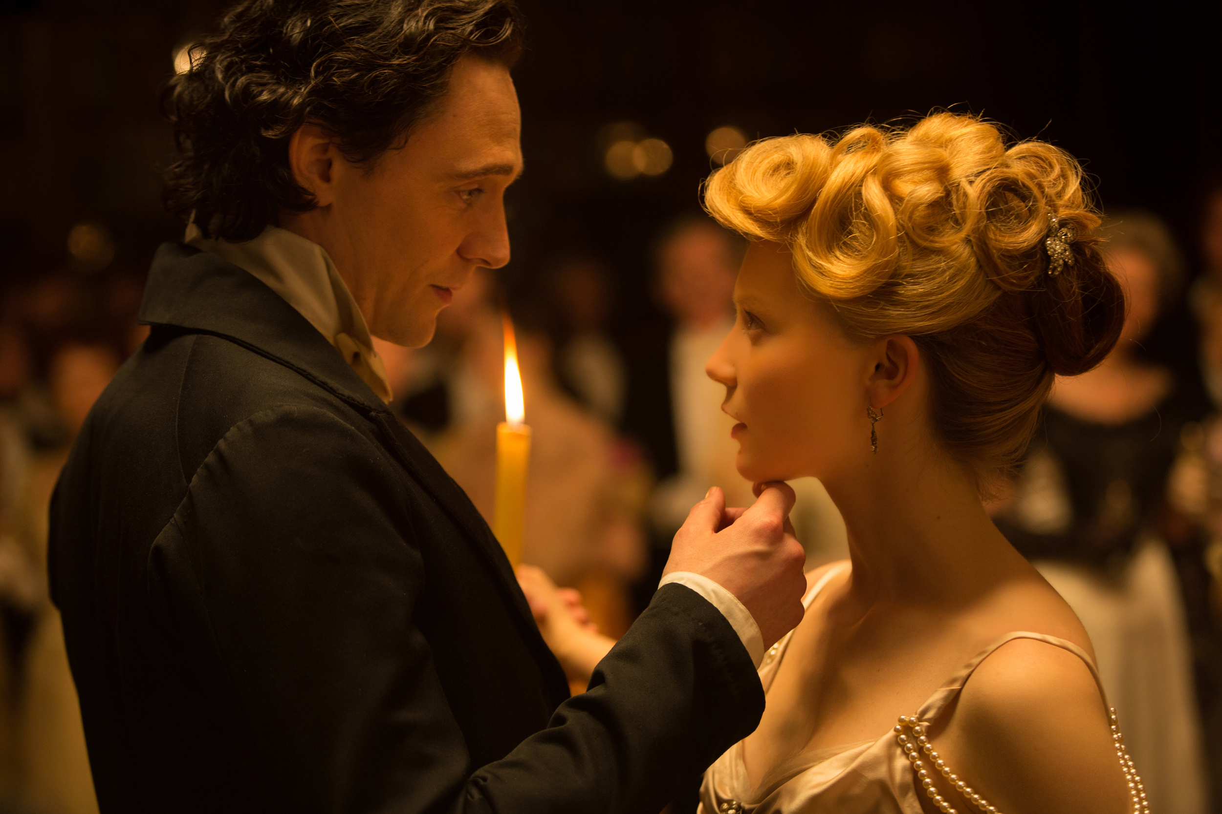 """In this image released by Legendary Pictures and Universal Pictures, Tom Hiddleston, left, and Mia Wasikowska appear in a scene from """" Crimson  Peak ."""" (AP)"""