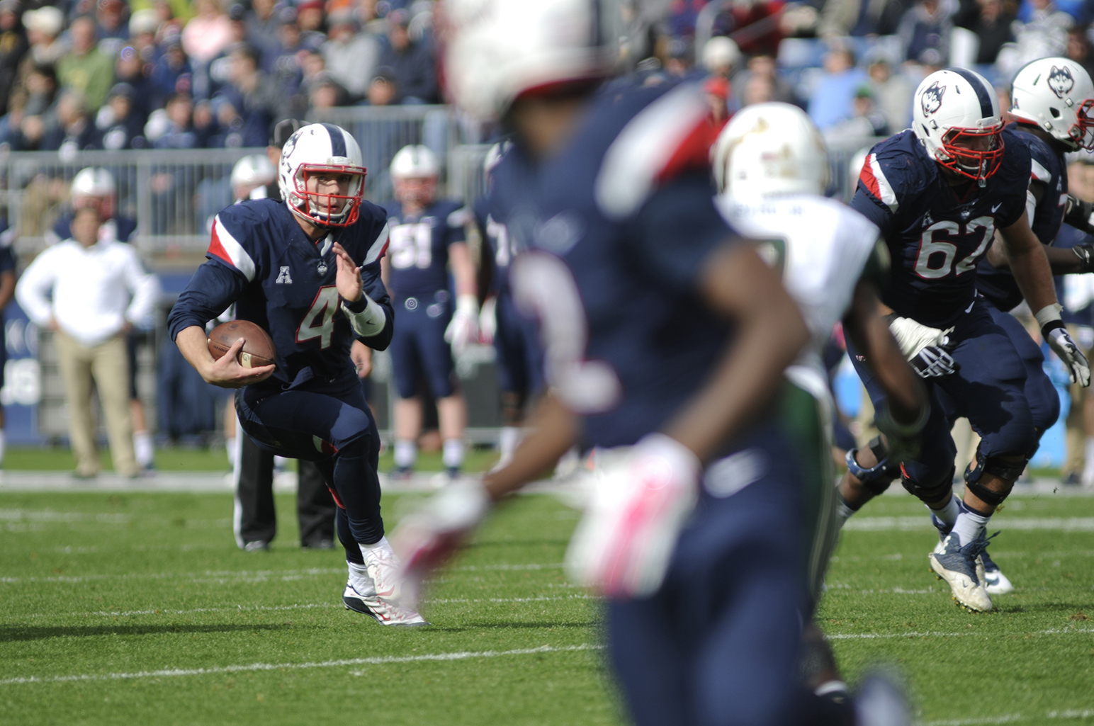 Quarterback Bryant Shirreffs scrambles for yards during UConn's 28-20 loss against USF on Oct. 17, 2015. The Huskies will take on East Carolina on Saturday. (Bailey Wright/The Daily Campus)