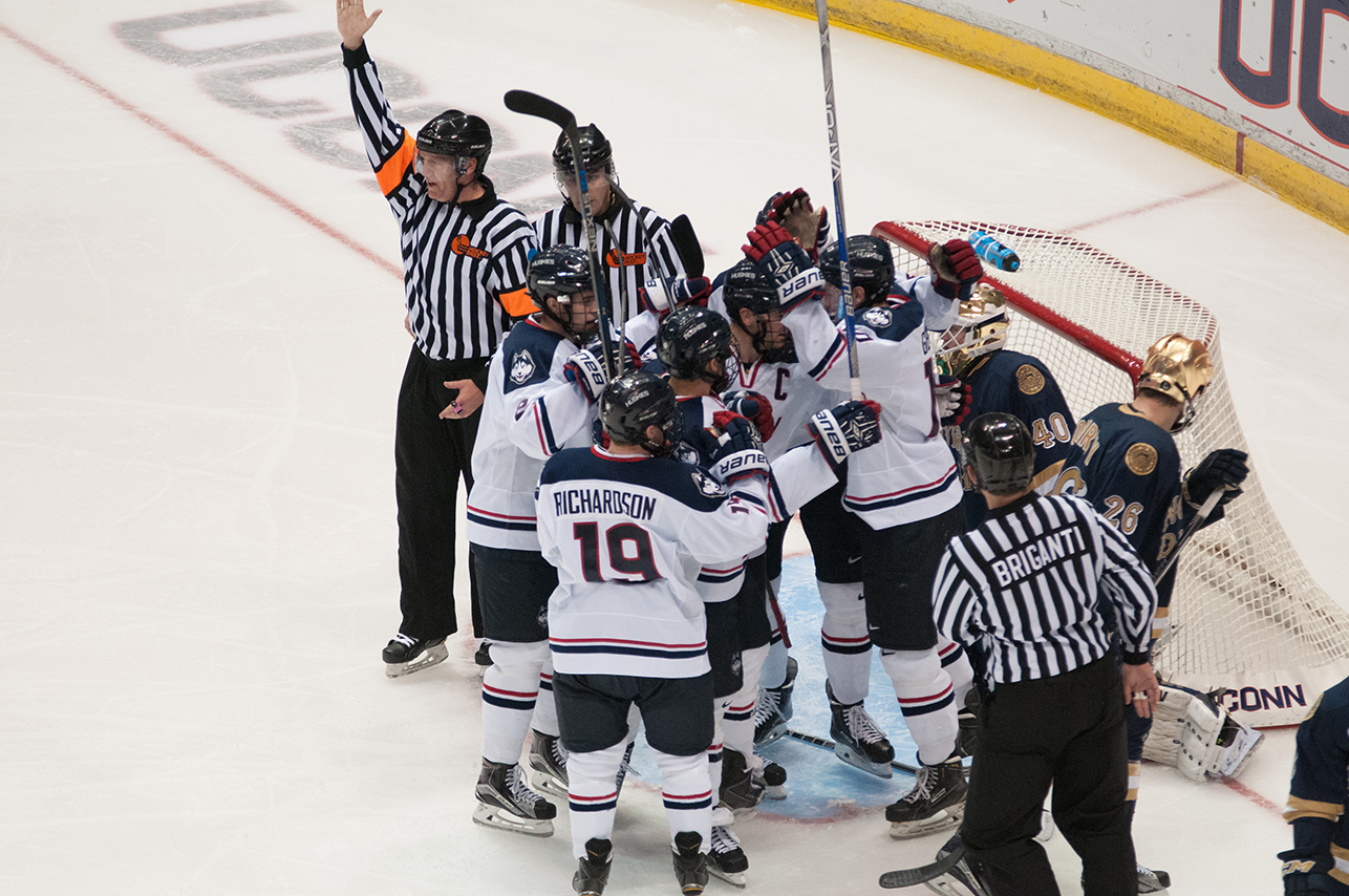Members of the UConn men's ice hockey team are seen surrounding the Notre Dame goal during their game against the Irish at the Barclays Center in Brooklyn, New York on Sunday, Nov. 1, 2015. (Jackson Haigis/The Daily Campus)