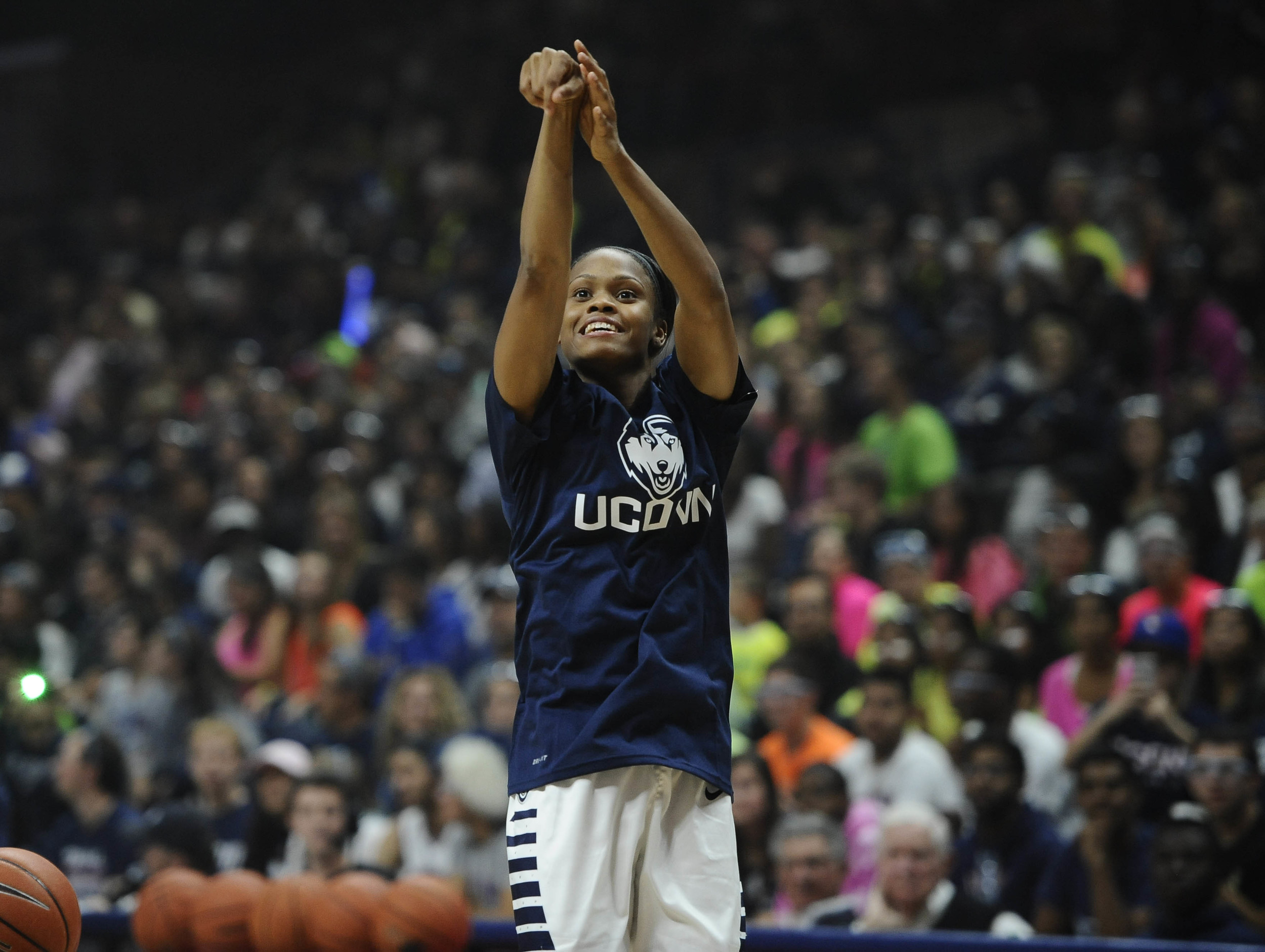 Connecticut's Moriah Jefferson competes in the three-point competition during the UConn men's and women's NCAA basketball teams' First Night event, Friday, Oct. 16, 2015, in Storrs, Conn. Jefferson won the competition. UConn opens their exhibition season Monday night. (AP)