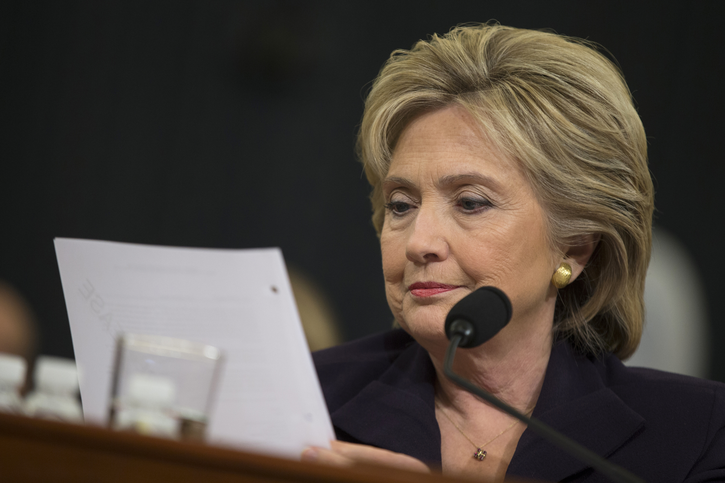 Democratic presidential candidate, former Secretary of State Hillary Rodham Clinton looks at an email sent by Ambassador Chris Stevens during her testimony before the House Benghazi Committee, Thursday, Oct. 22, 2015, on Capitol Hill in Washington. (Evan Vucci/AP)