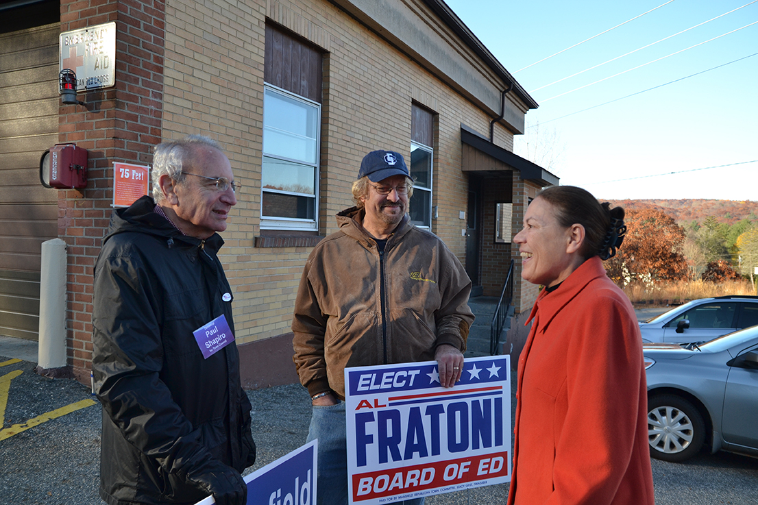 Voting locations were spread across the Town of Mansfield and included the Mansfield Community Center (District 1), Eagleville Fire Department (District 2), Mansfield Library (District 3), and the Annie E. Vinton School (District 4). Paul Shapiro (left, Deputy Mayor and Democratic Candidate), Al Fratoni (middle,Republican Board of Education candidate) and Virginia Raymond (right, Town Council member and Republican candidate) talk outside the Eagleville Fire Department. (Amar Batra/The Daily Campus)