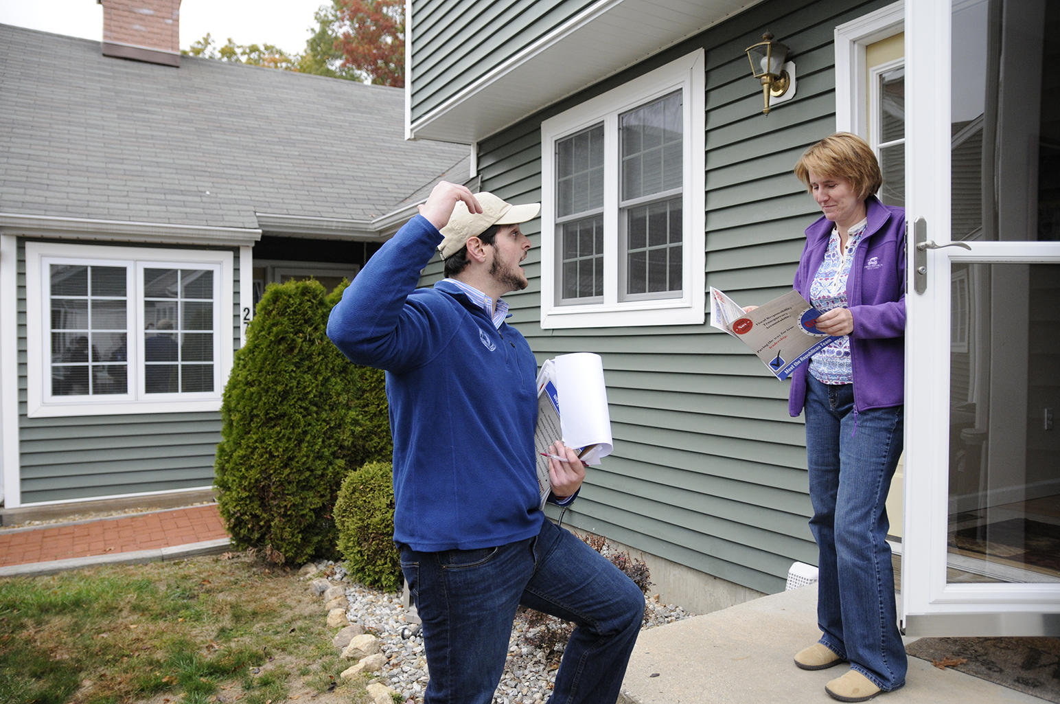 Sargent and other Republicans went door-to-door across Mansfield in order to get their message across to voters. Here Sargent talks with a potential voter in the neighborhood of Freedom Green. (Amar Batra/The Daily Campus)