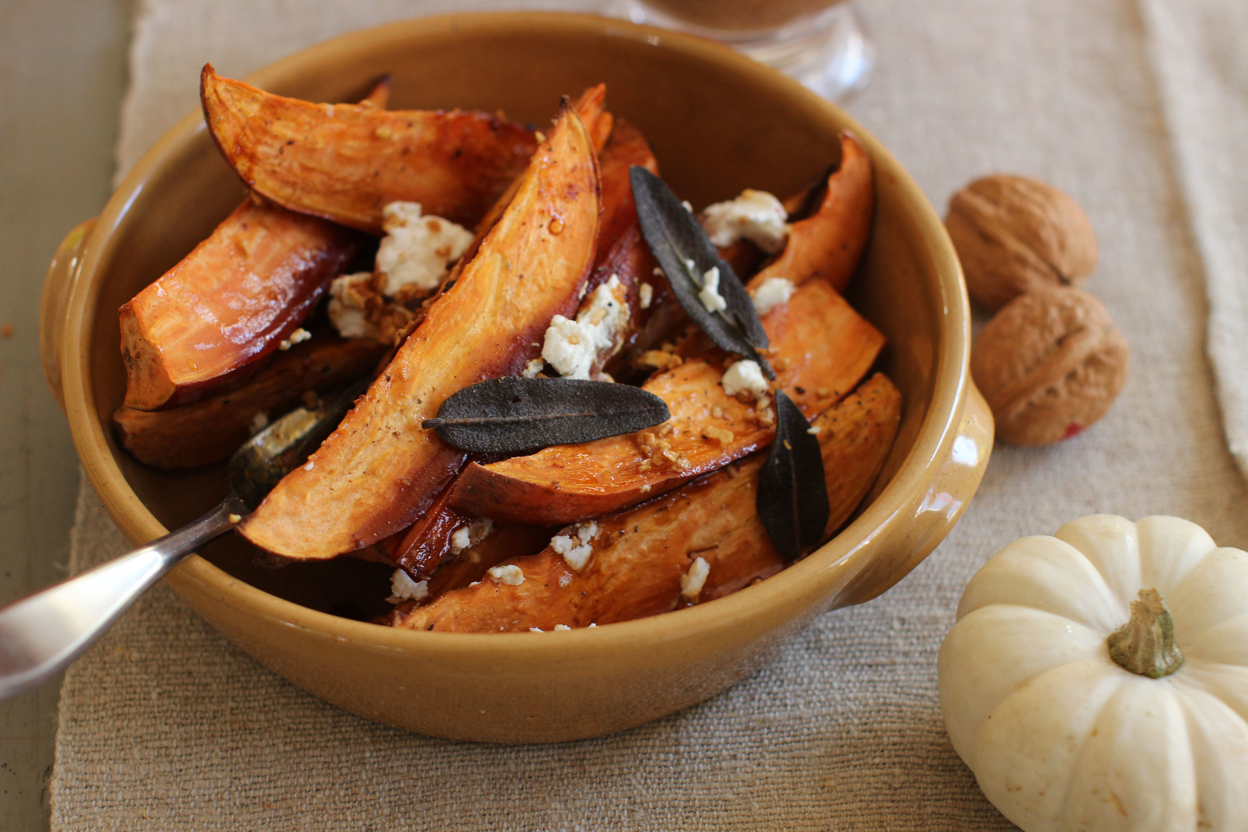 This Oct. 12, 2015, photo shows cider-glazed sweet potatoes with fried sage, garlic and goat cheese in Concord, N.H. (AP)