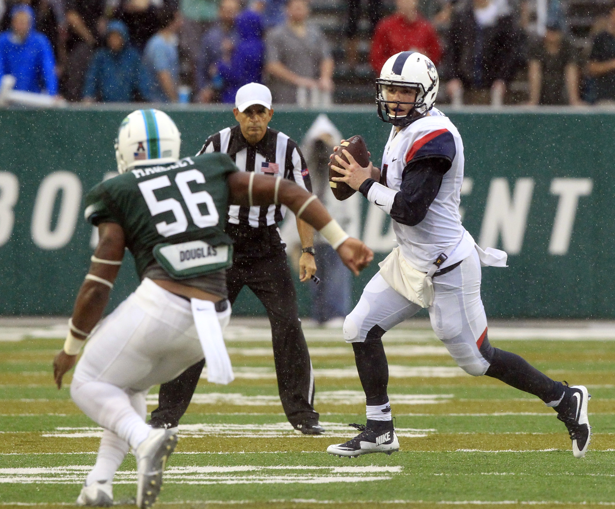 Connecticut quarterback Bryant Shirreffs (4) scrambles out of the pocket as Tulane linebacker Rae Juan Marbley (56) closes in during an NCAA college football game at Yulman Stadium in New Orleans, La. Saturday, Nov. 7, 2015. (A.J. Sisco/The Advocate via AP)