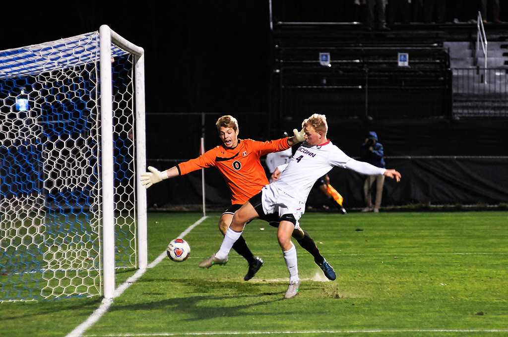 UConn men's soccer defender Simen Olafsen kicks the ball into the net after a set piece during the Huskies' game against Temple during the American Athletic Conference tournament quarterfinal at Joseph J. Morrone Stadium in Storrs, Connecticut on Saturday, Nov. 7, 2015. (Jason Jiang/The Daily Campus)