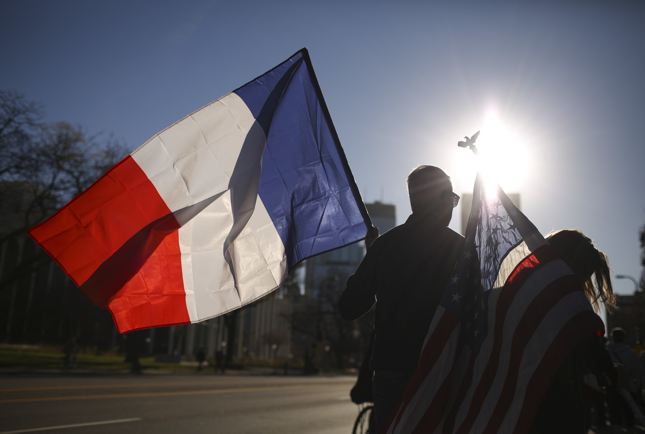 Joel and Sarah Quie carry American and French flags as they walk during a march in Minneapolis, Sunday, Nov. 15, 2015, to show solidarity with France after the deadly attacks in Paris on Friday. (Jeff Wheeler/Star Tribune via AP)