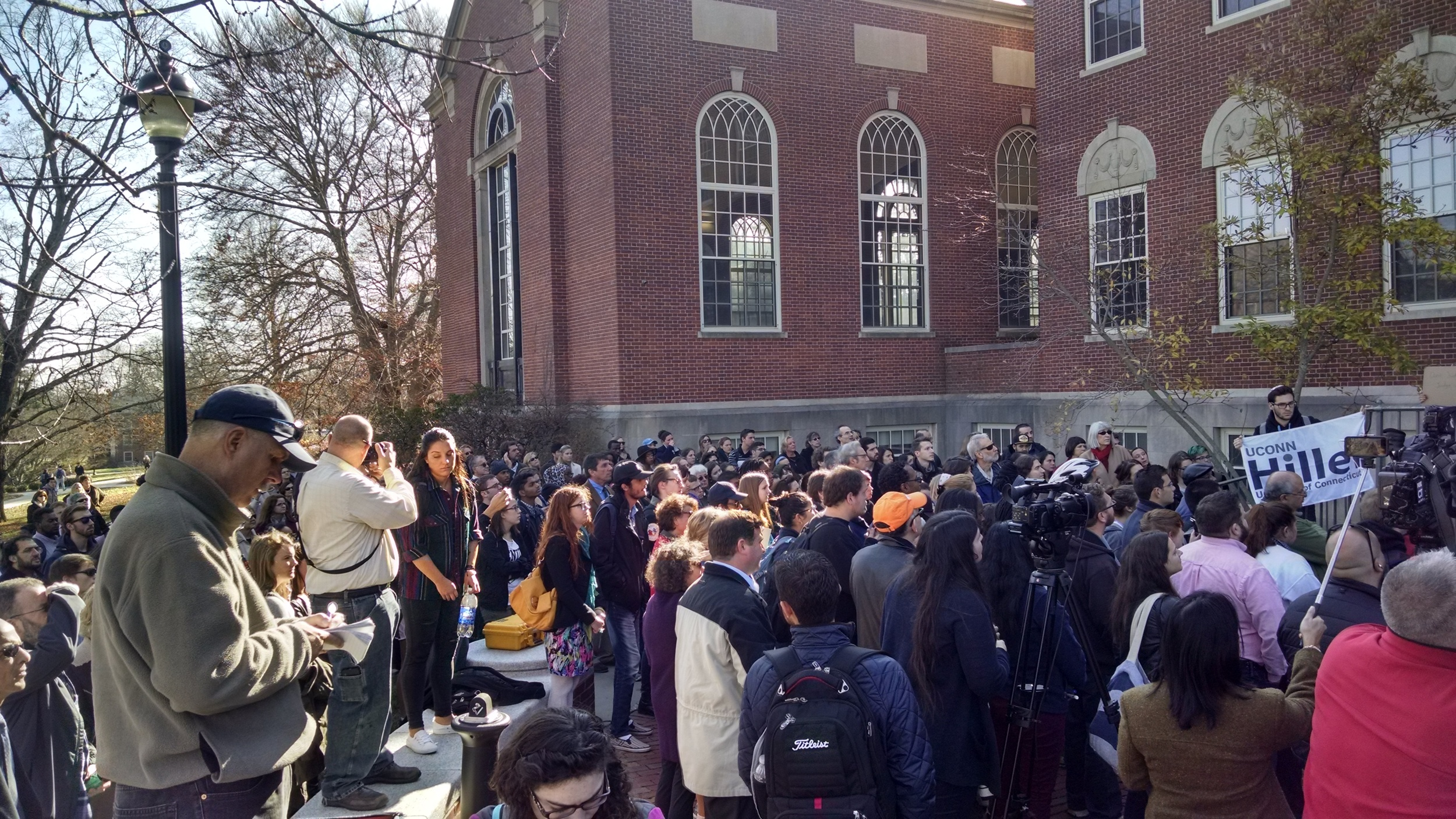 Students, faculty and administrators gathered outside of the Wilbur Cross building on Monday, Nov. 16, 2015 in a demonstration of solidarity against acts of hate on campus.Students addressed a crowd of several hundred gathered during the event.(Kyle Constable/The Daily Campus).
