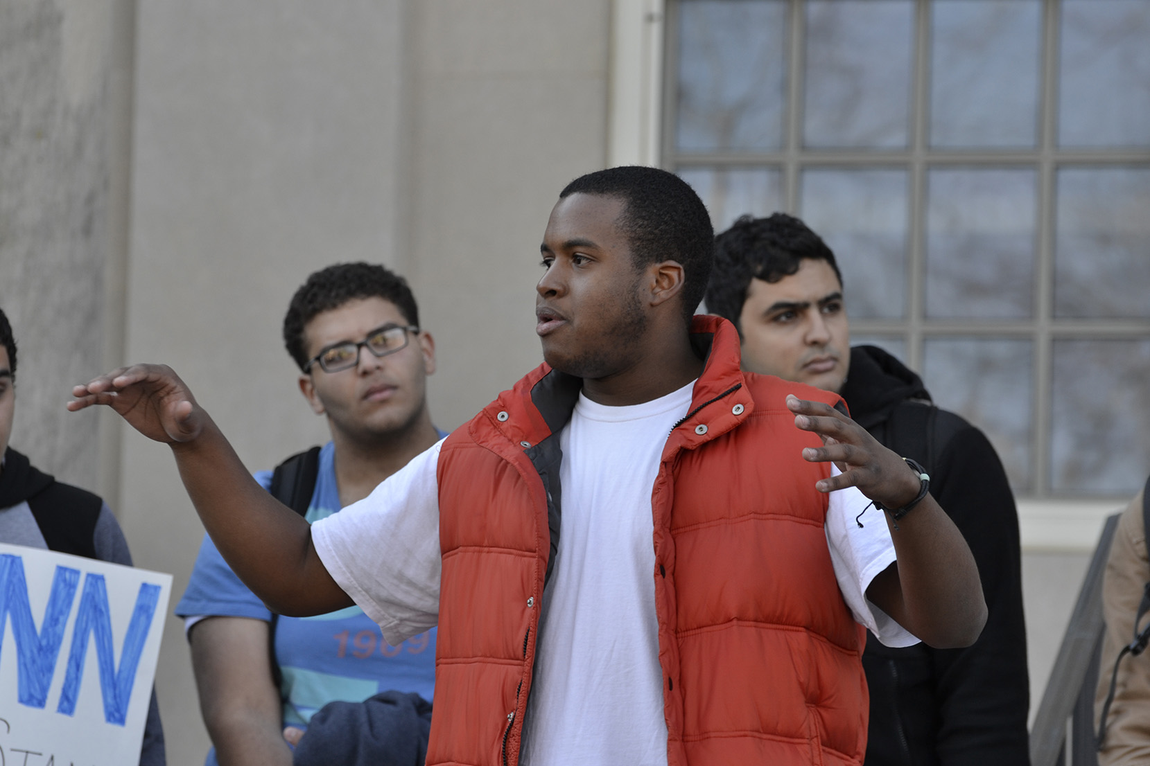 UConn senior biomedical engineering major Julian Rose addressed the crowd behind Wilbur Cross on November 16, 2015. The demonstration was held in response to the racist comments written on Mahmoud Hashem's dorm room door. (Rebecca Newman/The Daily Campus).