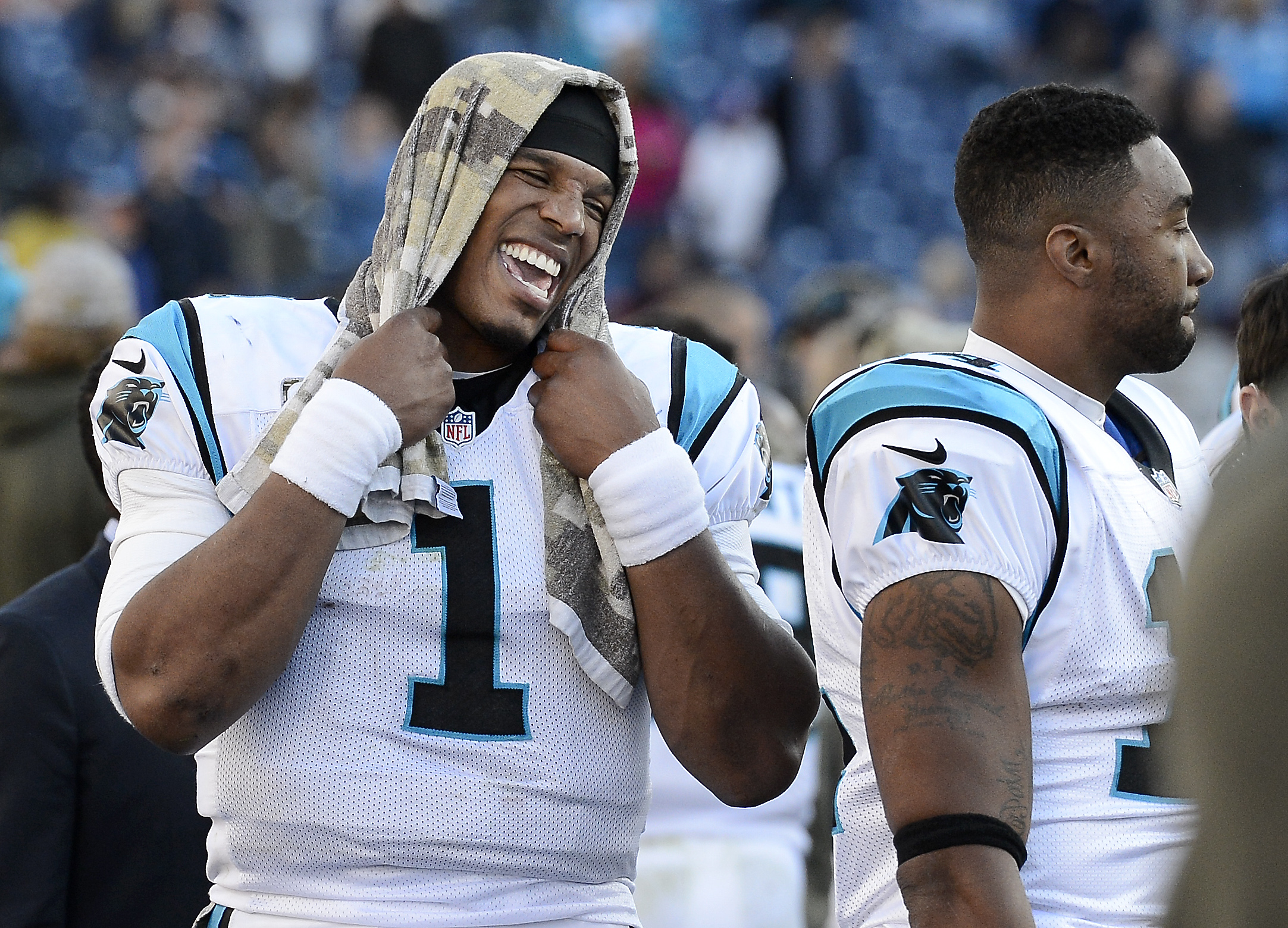 Carolina Panthers quarterback Cam Newton (1) laughs on the sideline in the closing minutes of the fourth quarter in the Panthers' 27-10 win over the Tennessee Titans in an NFL football game Sunday, Nov. 15, 2015, in Nashville, Tenn. (Mark Zaleski/AP)