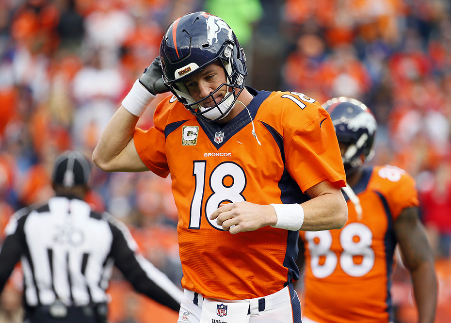 Denver Broncos quarterback  Peyton  Manning (18) takes off his helmet after throwing an interception during the first half of an NFL football game against the Kansas City Chiefs, Sunday, Nov. 15, 2015, in Denver. (AP