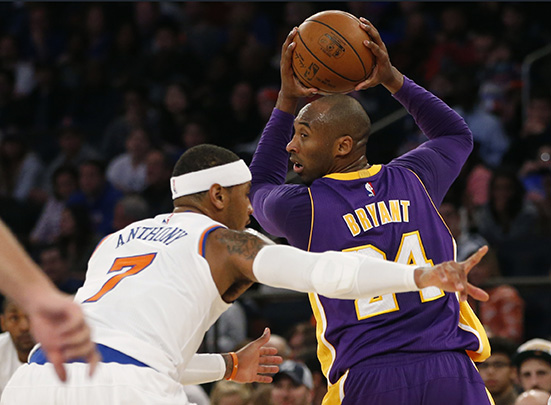 Los Angeles Lakers forward  Kobe Bryant (24) looks over his shoulder as he is guarded by New York Knicks' Carmelo Anthony (7) in the first half of an NBA basketball game at Madison Square Garden in New York, Sunday, Nov. 8, 2015. (AP