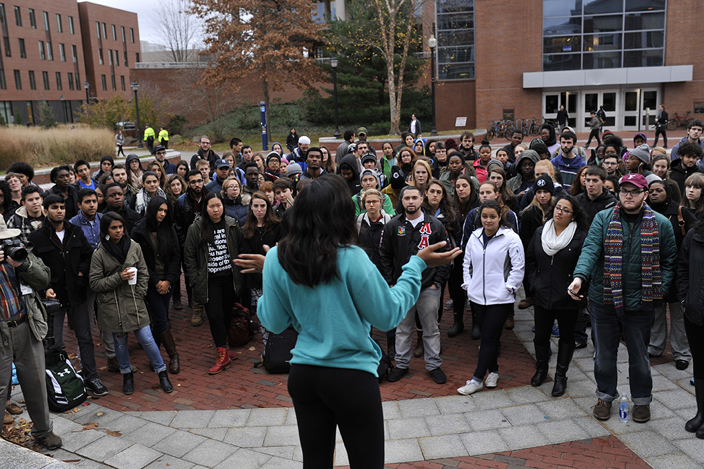 Nearly 300 UConn students gathered in the wind and rain on Fairfield Way to show solidarity with movements against racism happening on other campuses across the country on Thursday, Nov. 19, 2015. (Jason Jiang/The Daily Campus)