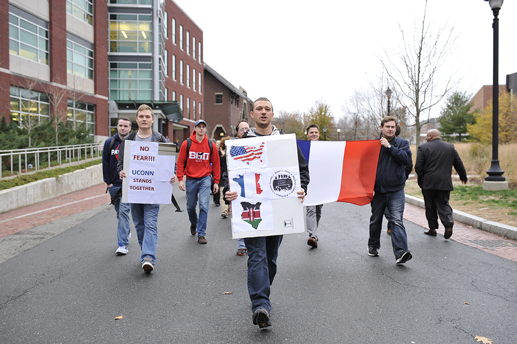"""UConn student Samuel Surowitz (middle) leads the UConn Veteran Student Organization march """"No Fear: A March in Solidarity With Victims & Against Terrorism,"""" down Fairfield Way in Storrs, Connecticut on Thursday, Nov. 19, 2015. (Jason Jiang/The Daily Campus)"""