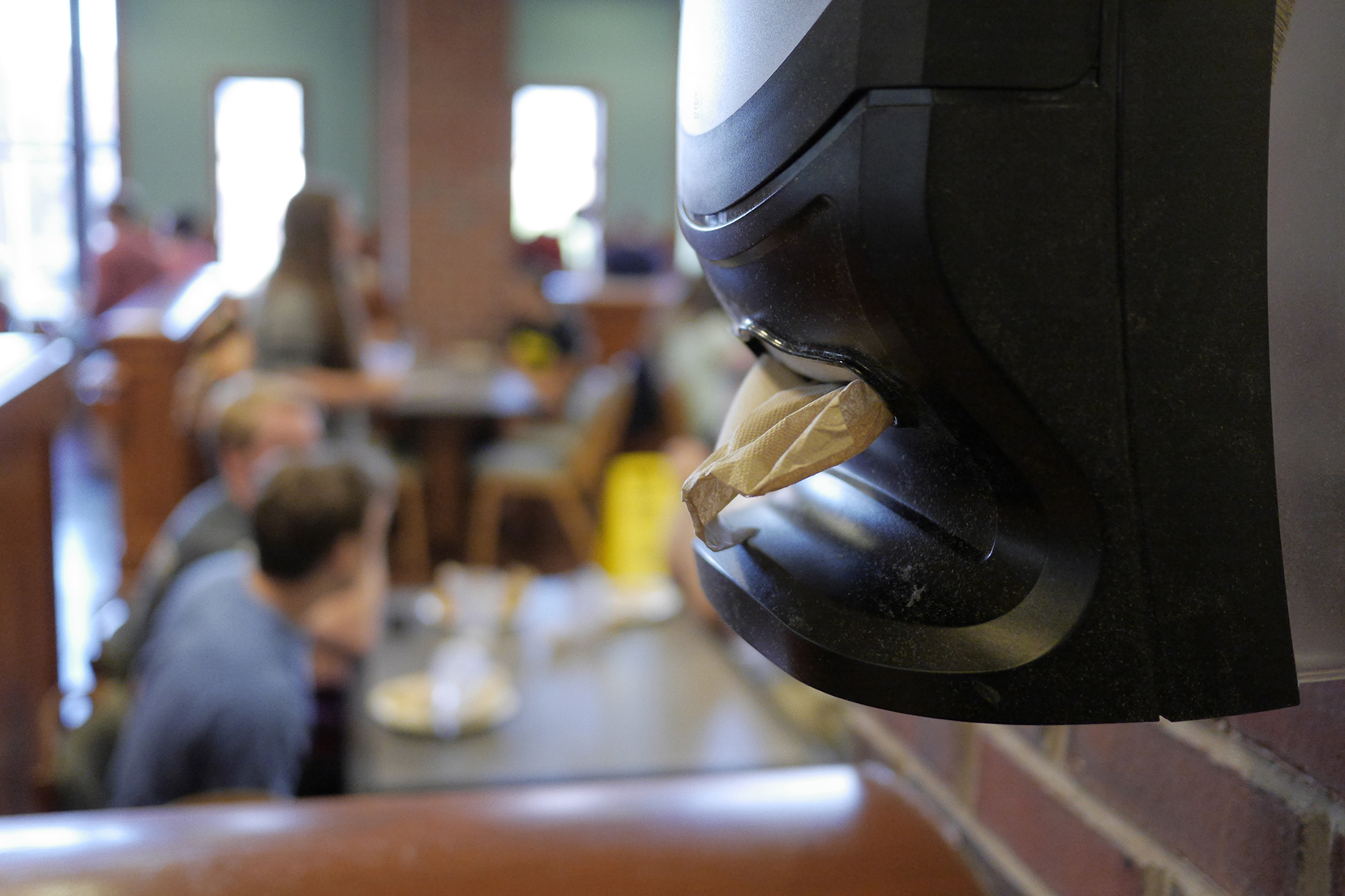 In this file photo, a wall-mounted napkin dispenser is seen in South Dining Hall. Dining Services recently shifted over to more widespread use of wall-mounted dispensers instead of having a dispenser on each table. (File Photo/The Daily Campus)