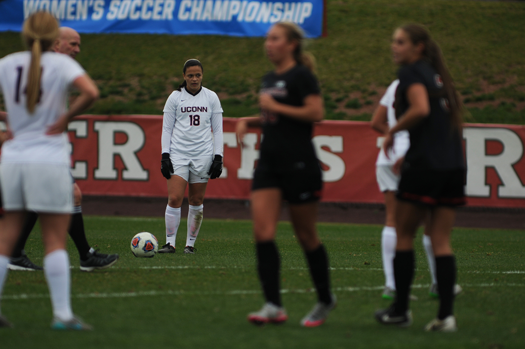 UConn redshirt junior forward Stephanie Ribeiro stands over the ball prior to taking a free kick during the Huskies' game against Rutgers in Piscataway, New Jersey on Sunday, Nov. 22, 2015. (Bailey Wright/The Daily Campus)