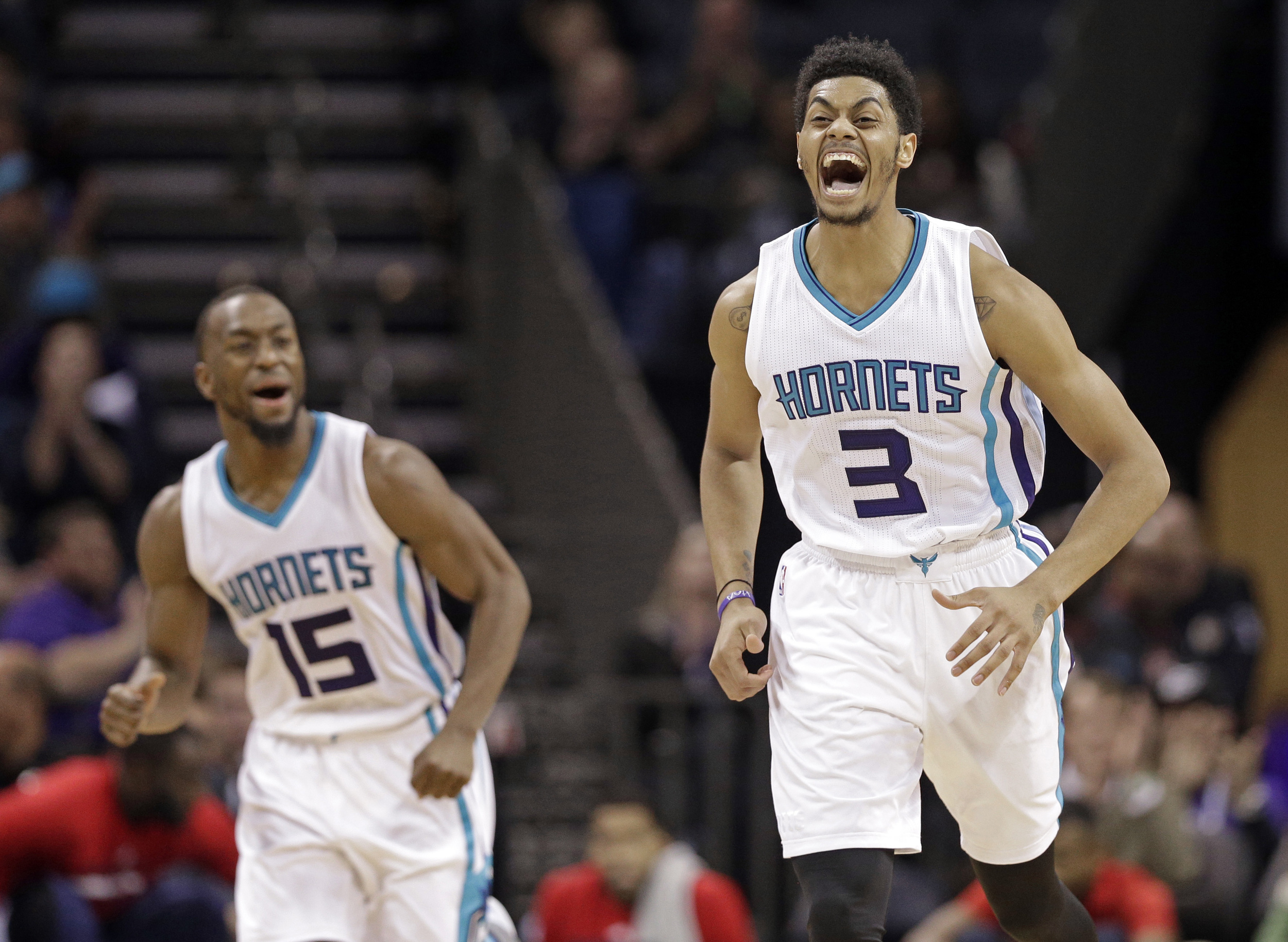 Charlotte Hornets' Jeremy Lamb (3) and Kemba Walker (15) react after Lamb's basket against the Washington Wizards in the second half of an NBA basketball game in Charlotte, N.C., Wednesday, Nov. 25, 2015. The Hornets won 101-87. (Chuck Burton/AP)