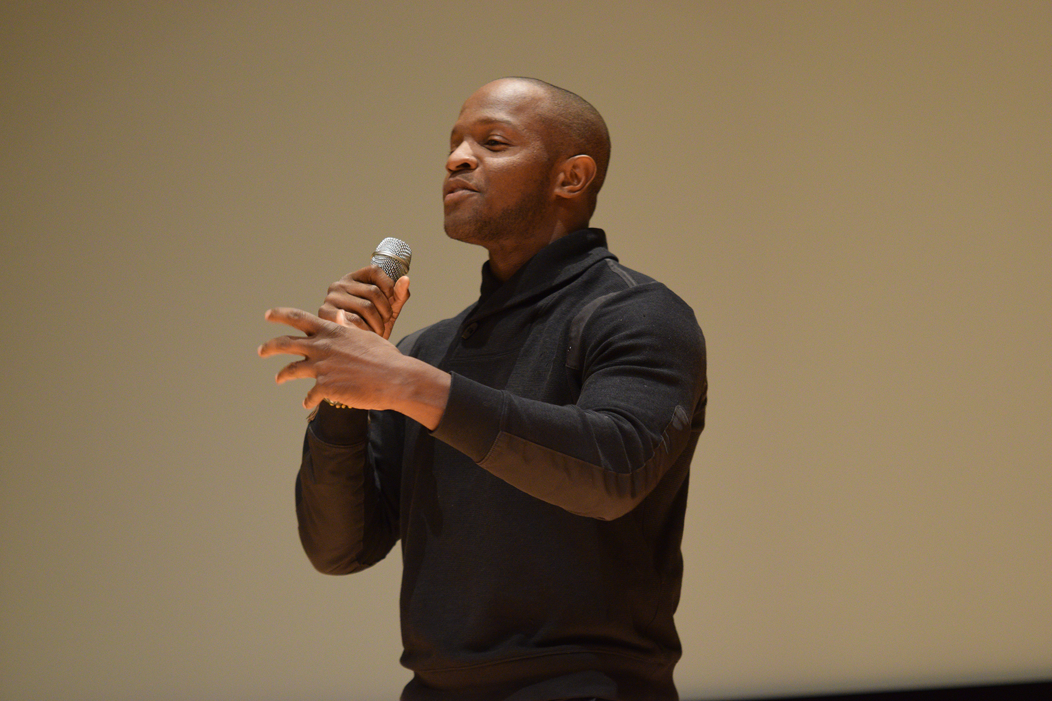 """Qasim Basir, writer and director of the 2010 film """"Mooz-Lum,"""" answers audience questions after a screening of the film in the UConn Student Union Theater in Storrs, Connecticut on Monday, Nov. 30, 2015. (Grant Zitomer/The Daily Campus)"""