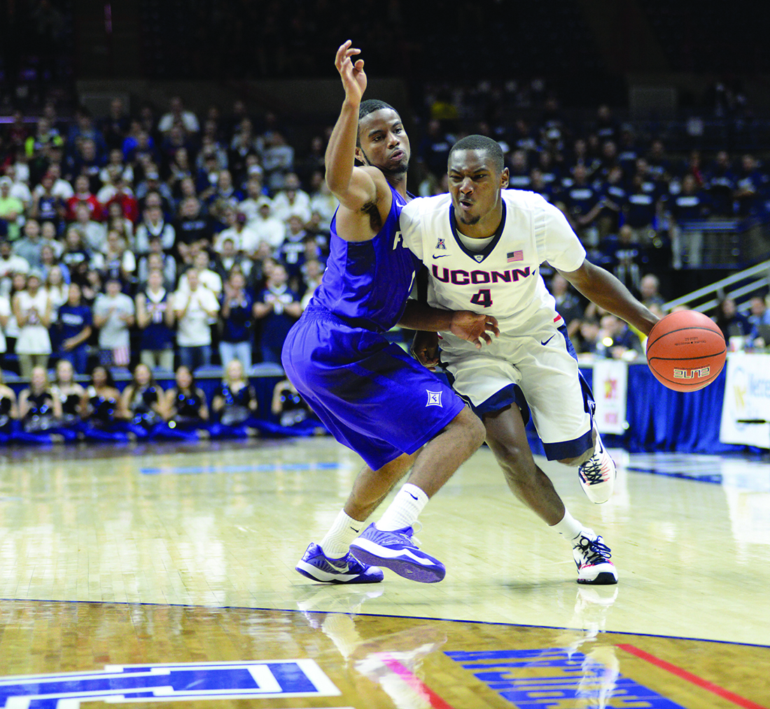 Grad guard Sterling Gibbs attacks the basket during UConn's victory over Furman. Gibbs is averaging 12.3 points per game. (Ashley Maher/The Daily Campus).