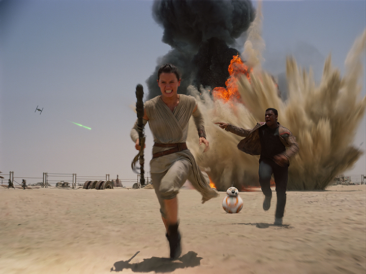 "This photo provided by Disney shows Daisey Ridley as Rey, left, and John Boyega as Finn, in a scene from the new film, ""Star Wars: Episode VII - The Force Awakens,"" directed by J.J. Abrams. The movie releases in the U.S. on Dec. 18, 2015. (Film Frame/Disney/Copyright Lucasfilm 2015 via AP)"