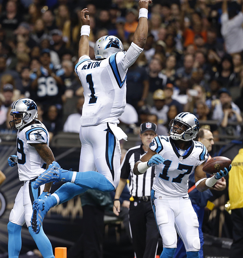 Carolina Panthers wide receiver Devin Funchess (17) celebrates his touchdown reception with quarterback Cam Newton (1) in the second half of an NFL football game against the New Orleans Saints in New Orleans, Sunday, Dec. 6, 2015. (AP Photo/Jonathan Bachman)