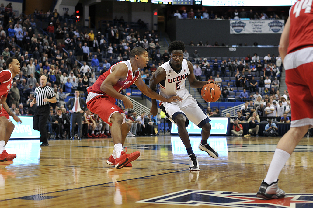 Daniel Hamilton (#5) drives to the rim during UConn's 82-49 win against Sacred Heart at the XL Center. Hamilton leads the Huskies in assists and rebounds per game. (Bailey Wright/The Daily Campus).