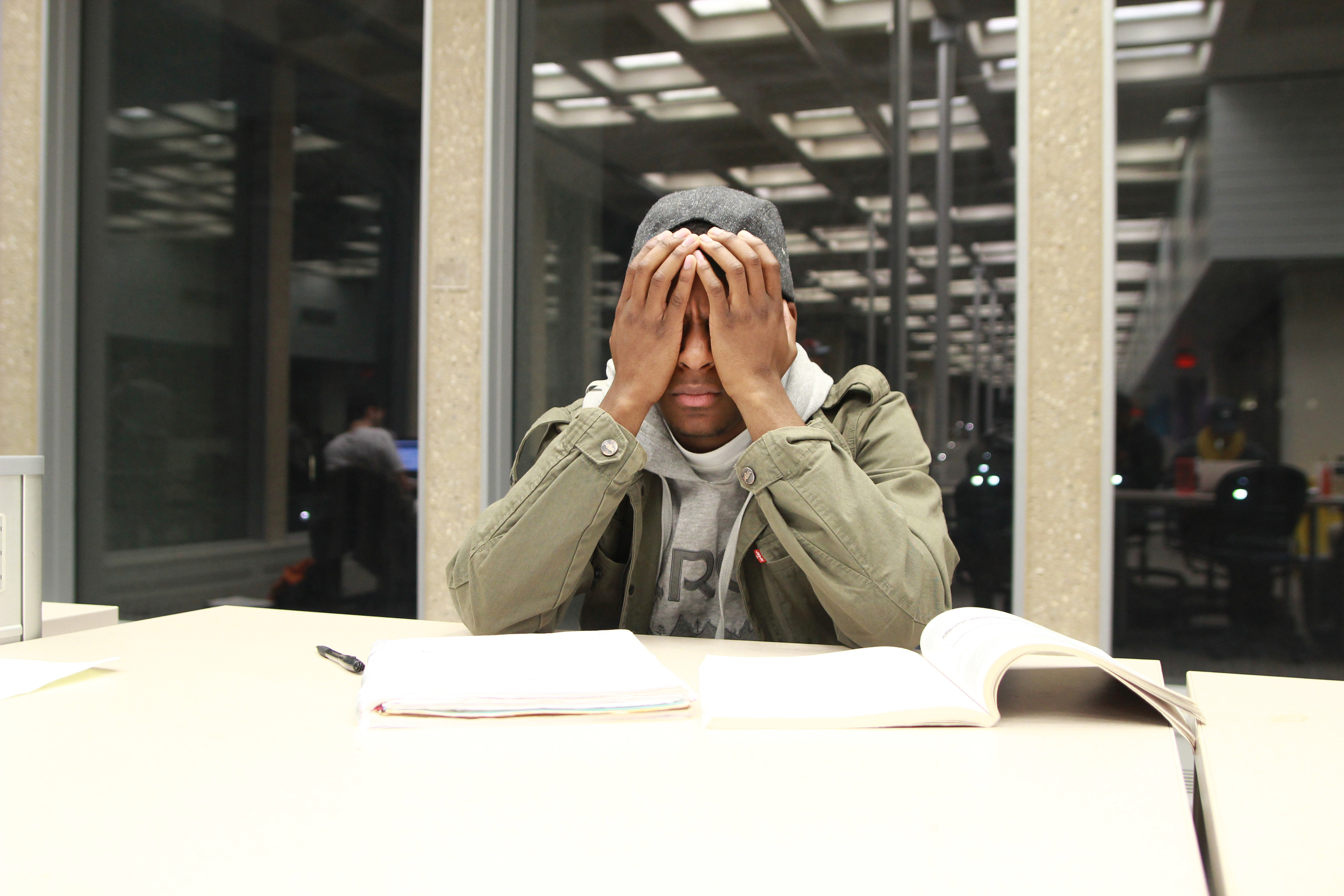 In this file photo, a stressed student in the library studies in Homer Babbidge library. A recent study by the student activities department shows that academics are one of the top two stresses in student leaders. (File photo/The Daily Campus)