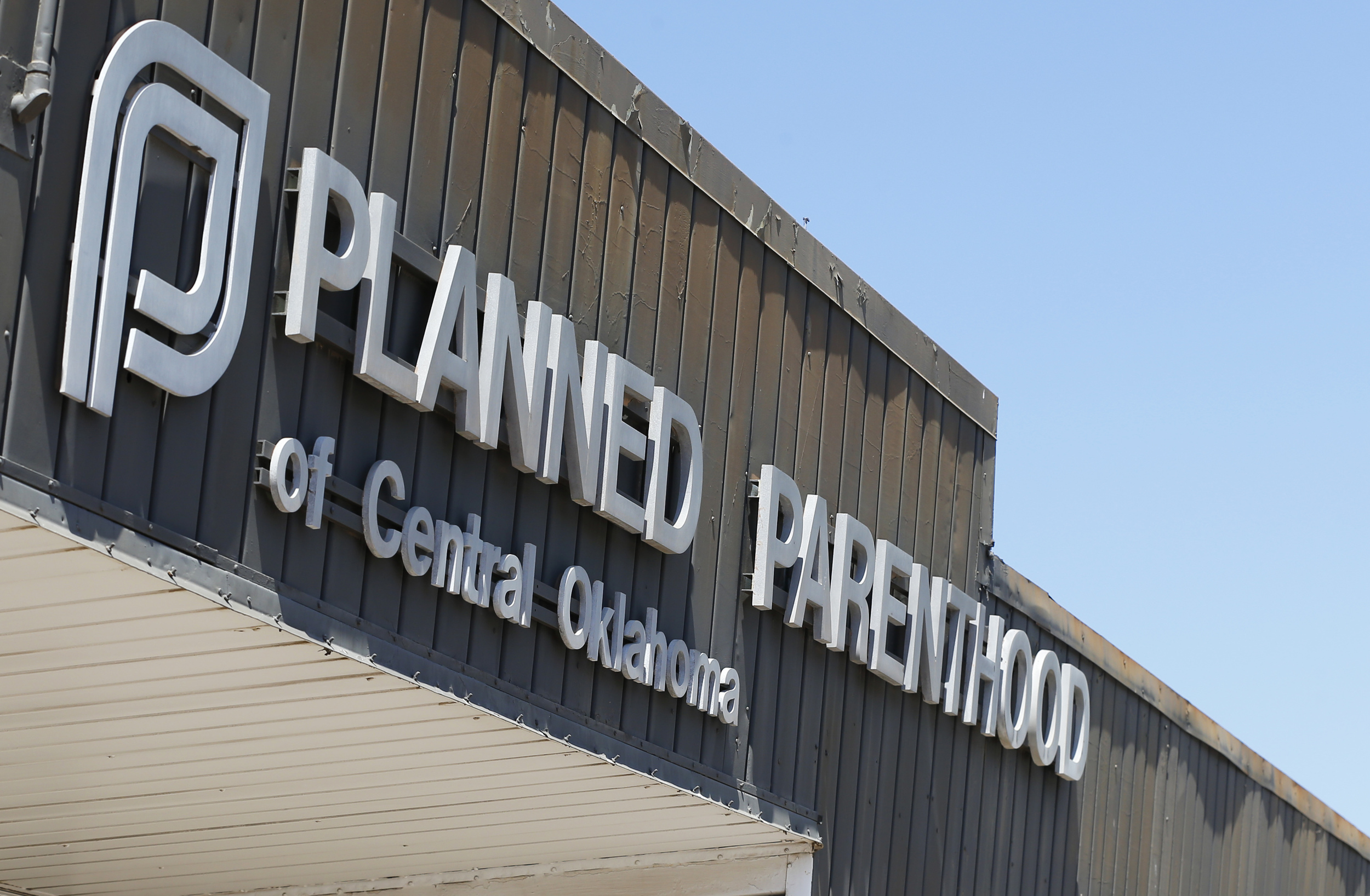 """In this July 24, 2015, file photo, a sign at a Planned Parenthood Clinic is pictured in Oklahoma City. Oklahoma Gov. Mary Fallin is urging the state's Medicaid provider to cancel its contracts with two Planned Parenthood affiliates, citing what she called a """"high rate of billing errors."""" (Sue Ogrocki, File/AP)"""