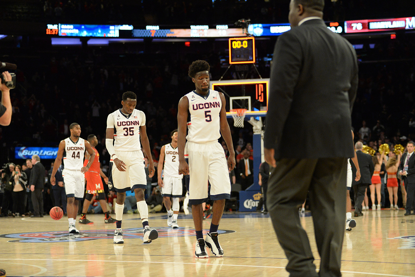 UConn men's basketball forward Daniel Hamilton (5), center Amida Brimah (35) and other members of the team are seen walking off the court after losing to No. 6 Maryland at Madison Square Garden in New York on Tuesday, Dec. 8, 2015. (Ashley Maher/The Daily Campus)