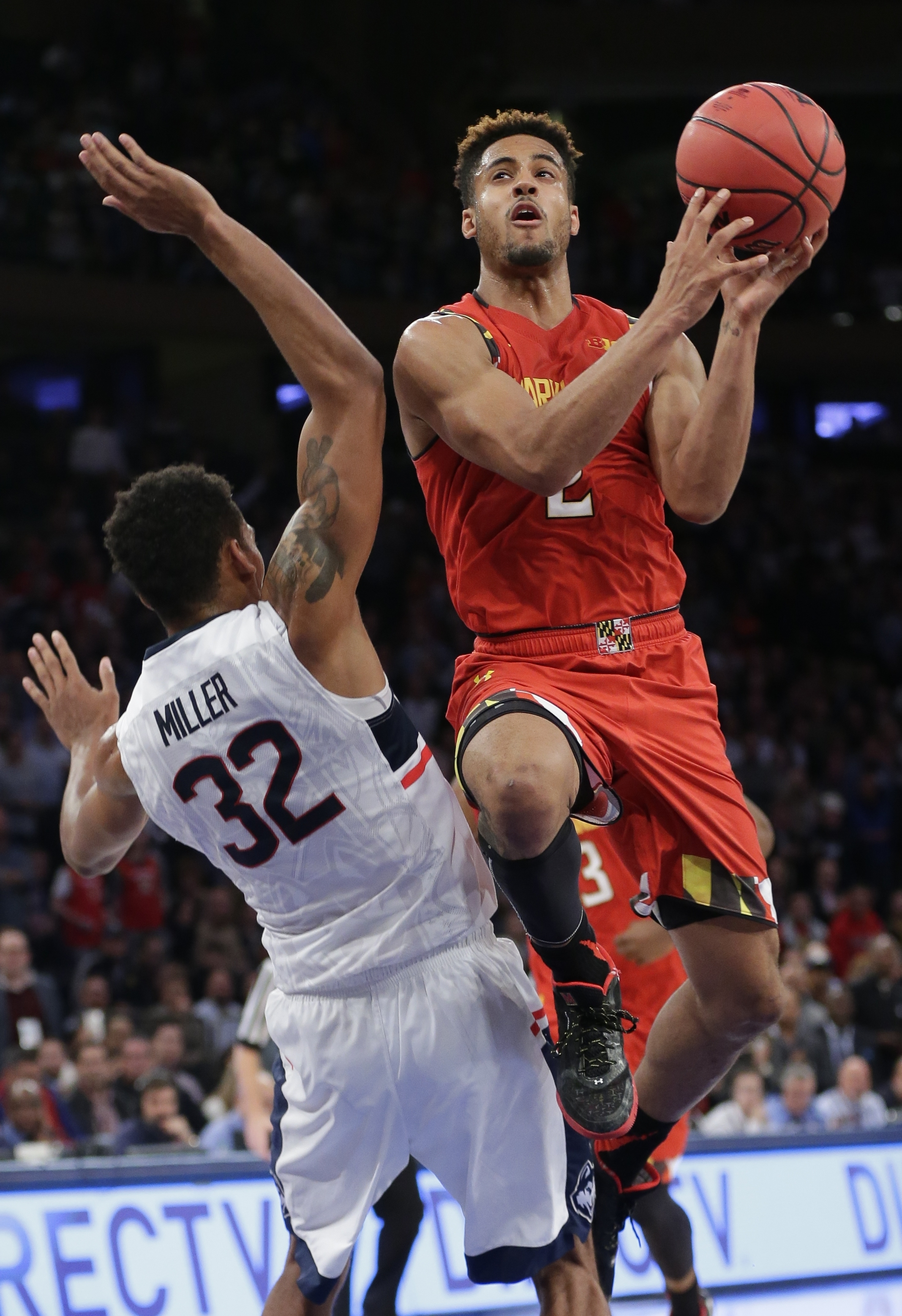 Maryland's Melo Trimble (2) drives past Connecticut's Shonn Miller (32) during the second half of an NCAA college basketball game, Tuesday, Dec. 8, 2015, in New York. Maryland won 76-66. (AP Photo/Frank Franklin II)