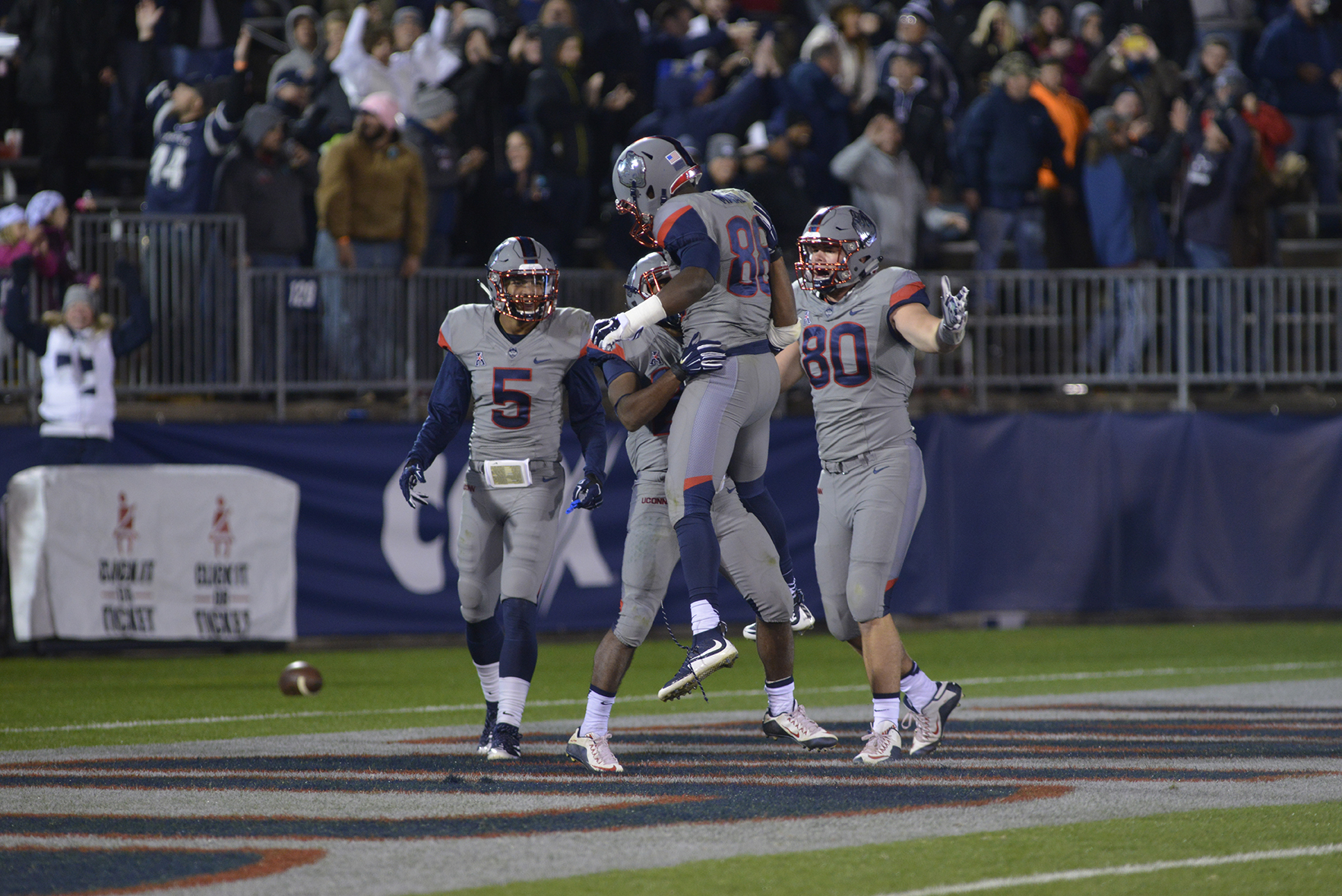UConn players celebrate after a touchdown from running back Arkeel Newsome (second from left) during the Huskies' game against East Carolina at Pratt & Whitney Stadium at Rentschler Field in East Hartford, Connecticut on Friday, Oct. 30, 2015. (Jason Jiang/The Daily Campus)