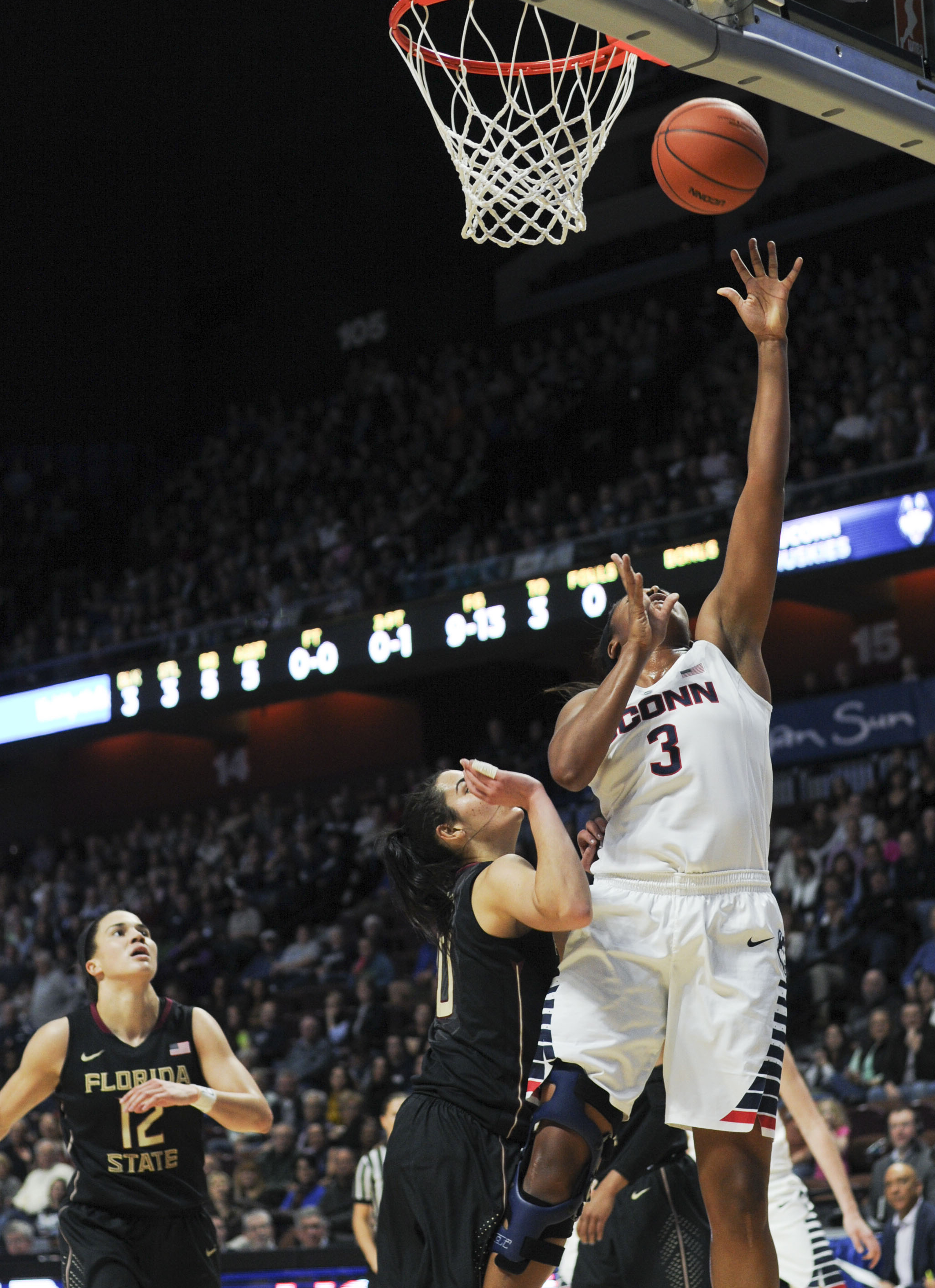 UConn forward Morgan Tuck goes for a layup against Florida State at the Hall of Fame Classic at Mohegan Sun Arena on Dec. 11, 2015. (Bailey Wright/The Daily Campus)