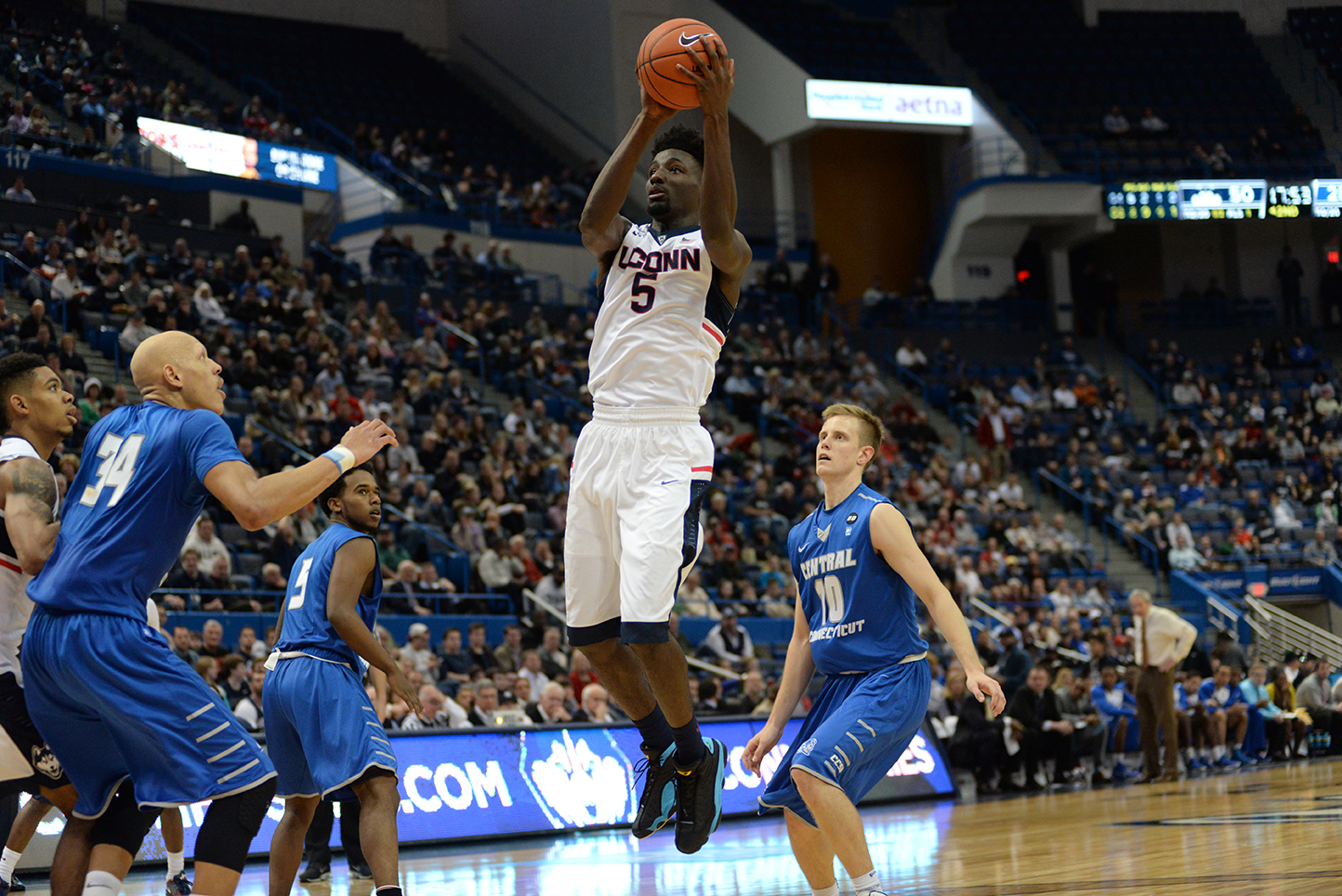 Forward Daniel Hamilton takes a jumper during UConn's 99-52 blowout of CCSU Wednesday afternoon. Hamilton finished with 11 points, 11 rebounds and 11 assists to record the 11th triple-double in school history. (Ashley Maher/The Daily Campus)