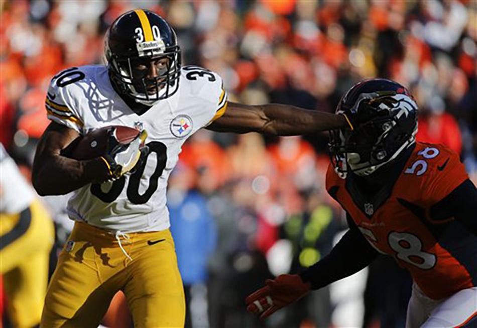 Pittsburgh Steelers running back  Jordan  Todman , left, pushes off Denver Broncos outside linebacker Von Miller during the first half in an NFL football divisional playoff game, Sunday, Jan. 17, 2016, in Denver. (AP Photo/Jack Dempsey)