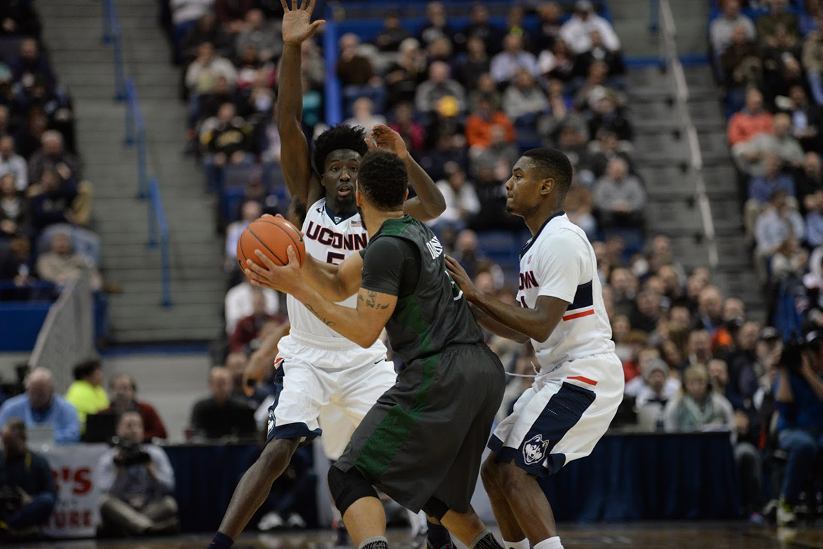 Daniel Hamilton, 5, and Sterling Gibbs double team a Tulane player during UConn's 60-42 win on Jan. 19, 2016 at the XL Center. The Huskies forced 16 turnovers, leading to 16 points. (Ashley Maher/The Daily Campus)